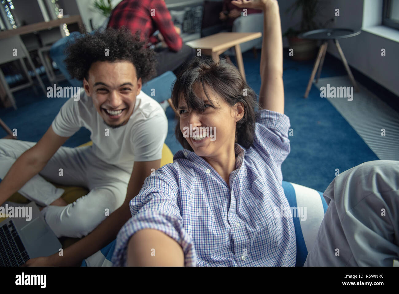 Group of happy smiling businesspeople making selfie and gesturing. Stock Photo