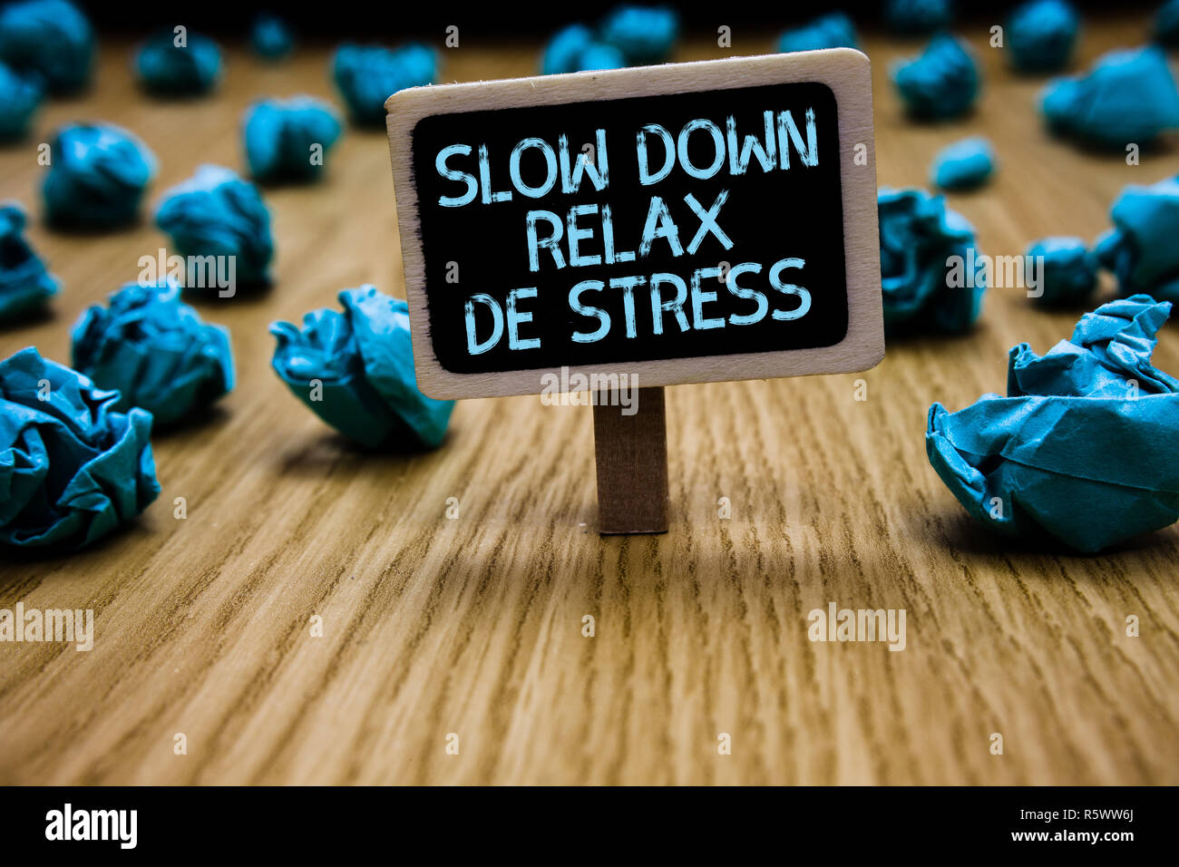 Word writing text Slow Down Relax De Stress. Business concept for Have a break reduce stress levels rest calm Paperclip hold black paperboard with tex - Stock Image