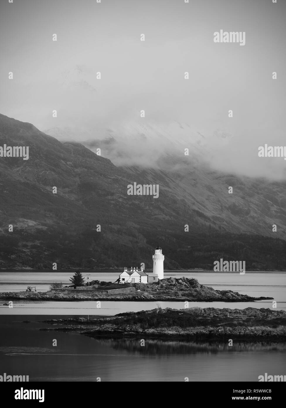 Popular view to Isle Ornsay Lighthouse. Rocky island south-east of Isle of Skye; Scotland, United Kingdom. - Stock Image