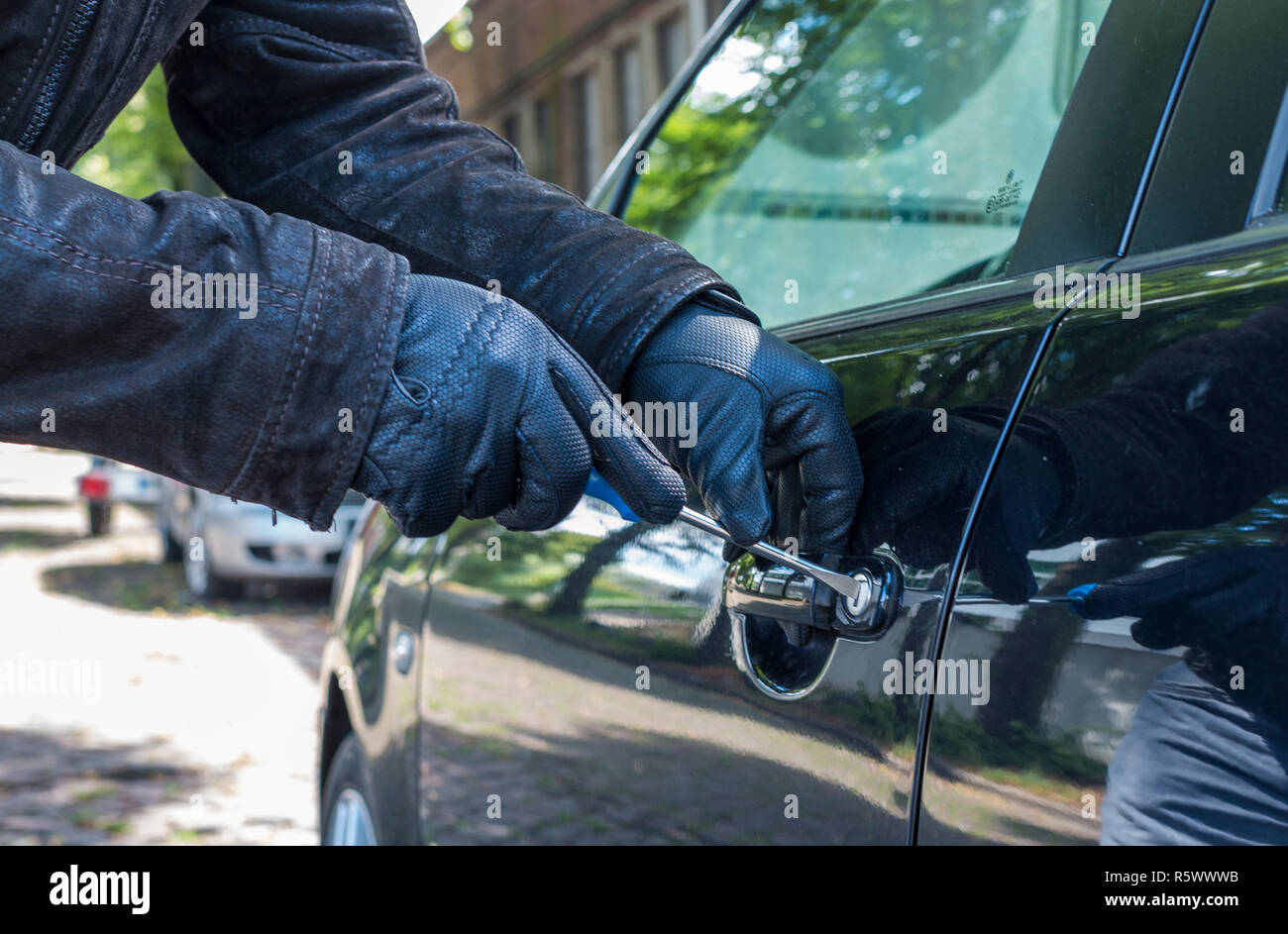 a person tries to break up a car - Stock Image