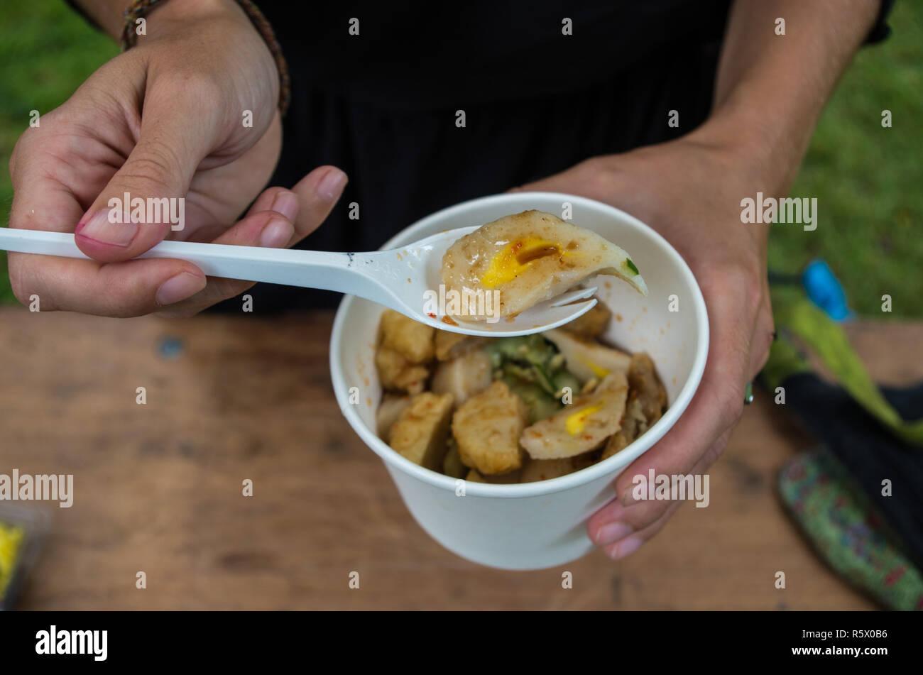 Pempek Palembang - fishcake delicacy from Palembang, Sumatra, Indonesia - Stock Image