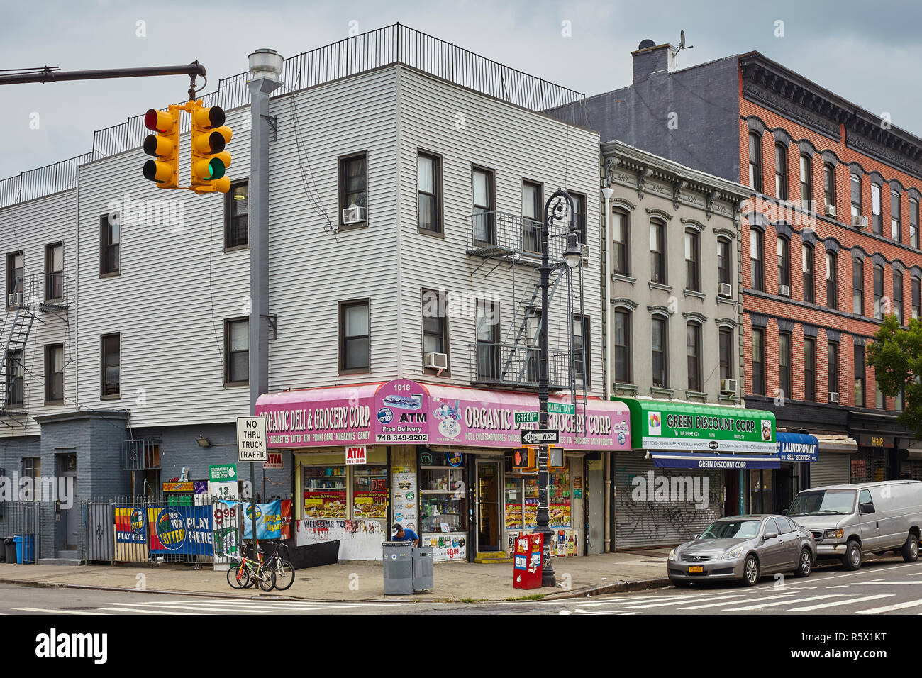 New York, USA - July 04, 2018: Shops at the corner of Manhattan Avenue and Green St. Greenpoint neighborhood is also know as Little Poland. - Stock Image