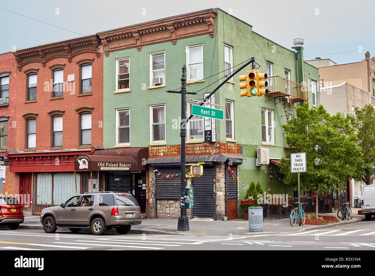 New York, USA - July 04, 2018: Kent Street in the Greenpoint neighborhood, also know as Little Poland, has a large Polish immigrant community with man - Stock Image