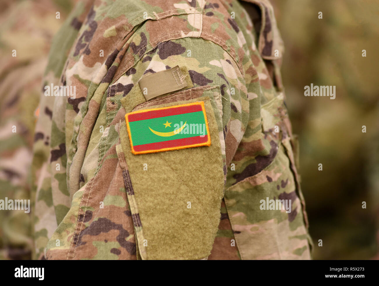 Flag of Mauritania on soldiers arm (collage). - Stock Image