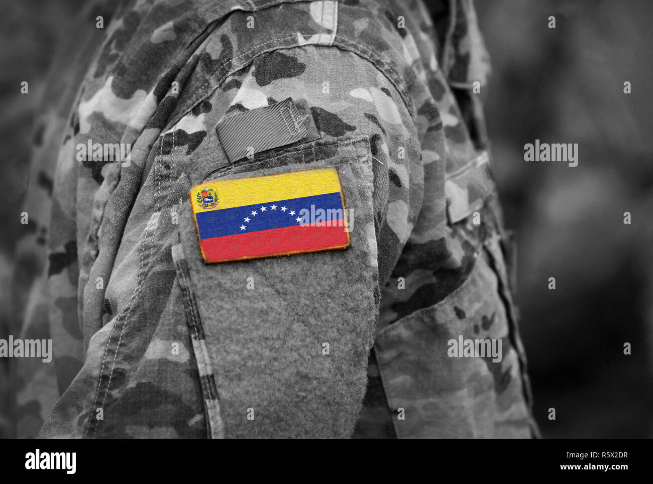 Flag of Venezuela on soldiers arm (collage). - Stock Image