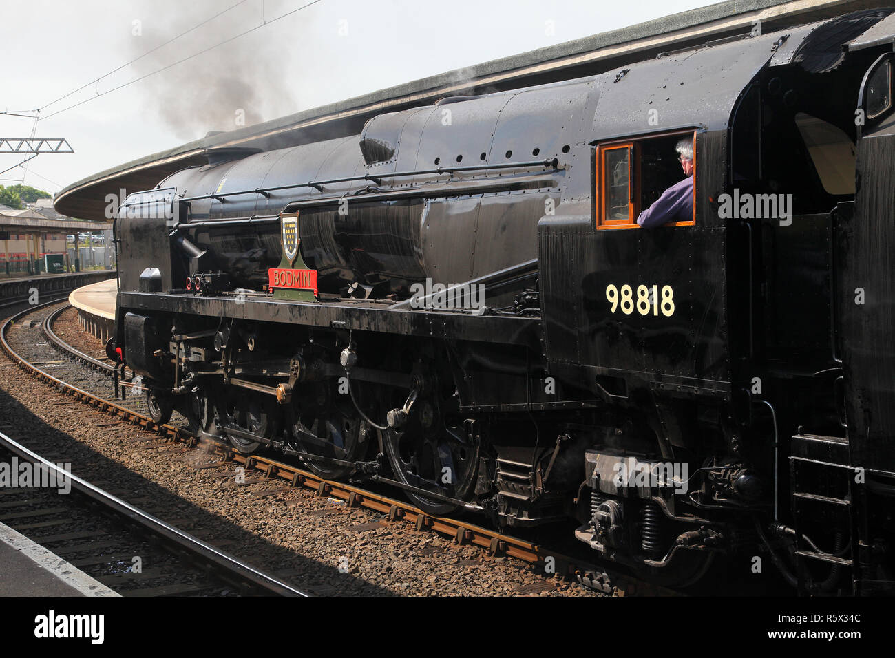 35018 British India Line with the Tops number 98818 and Bodmin nameplates on waits at Carnforth on 24.5.17. - Stock Image