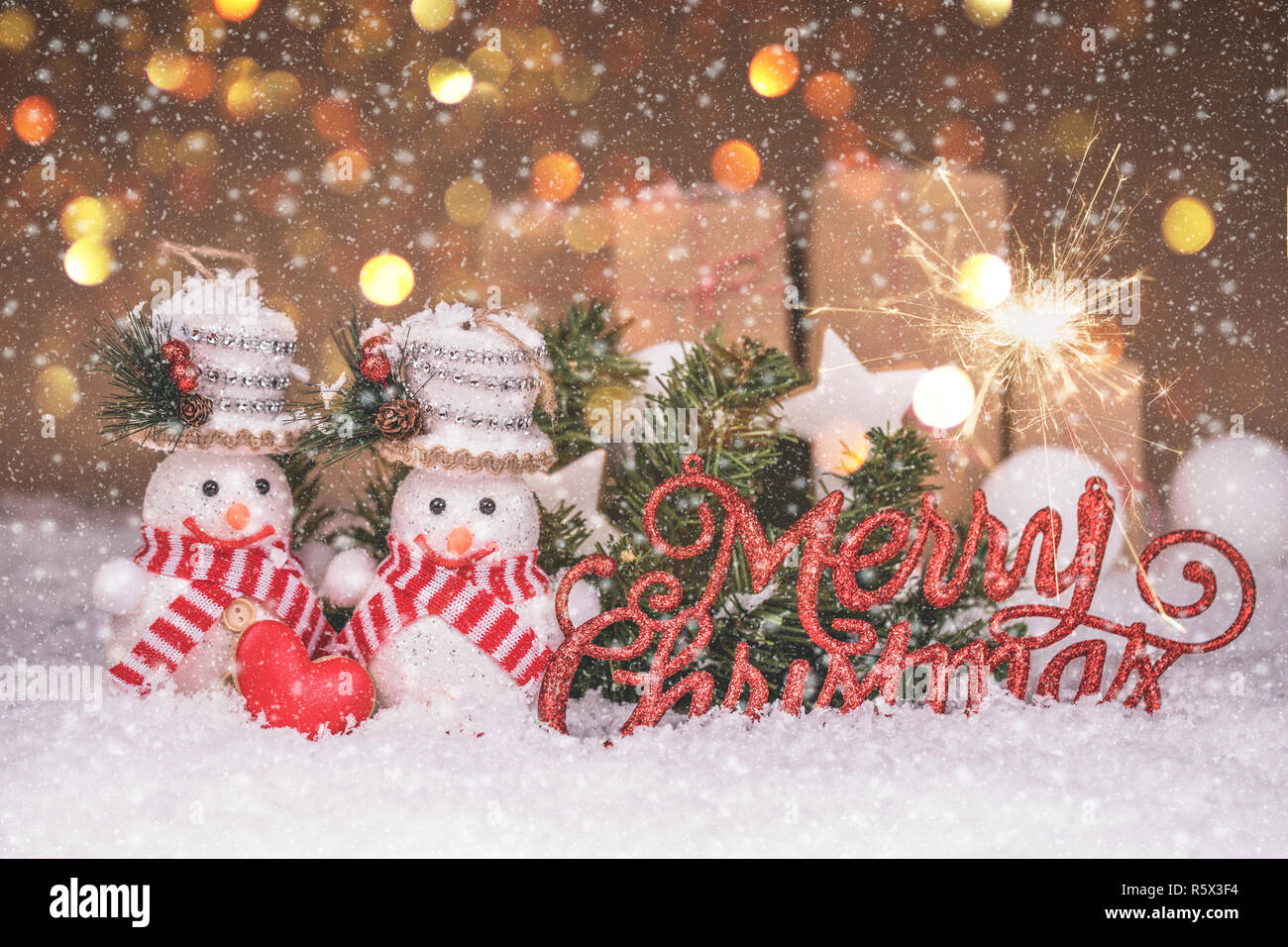 Snowman Couple With Red Heart Christmas Decorations And Snow Merry Christmas And Happy New Year Stock Photo Alamy