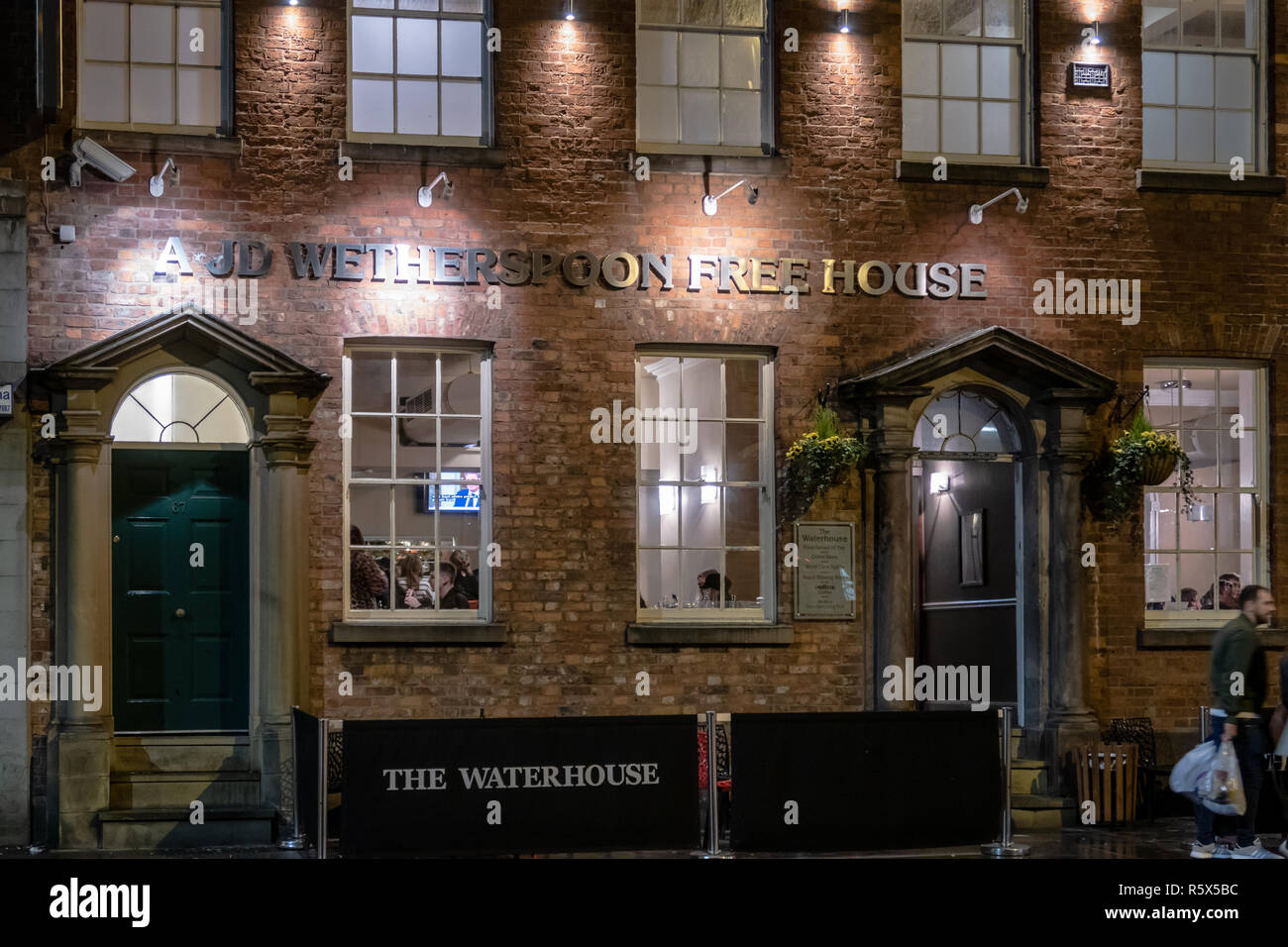 The Waterhouse, AJD Wetherspoons Free house in the evening on Princess street, Manchester, England Uk - Stock Image