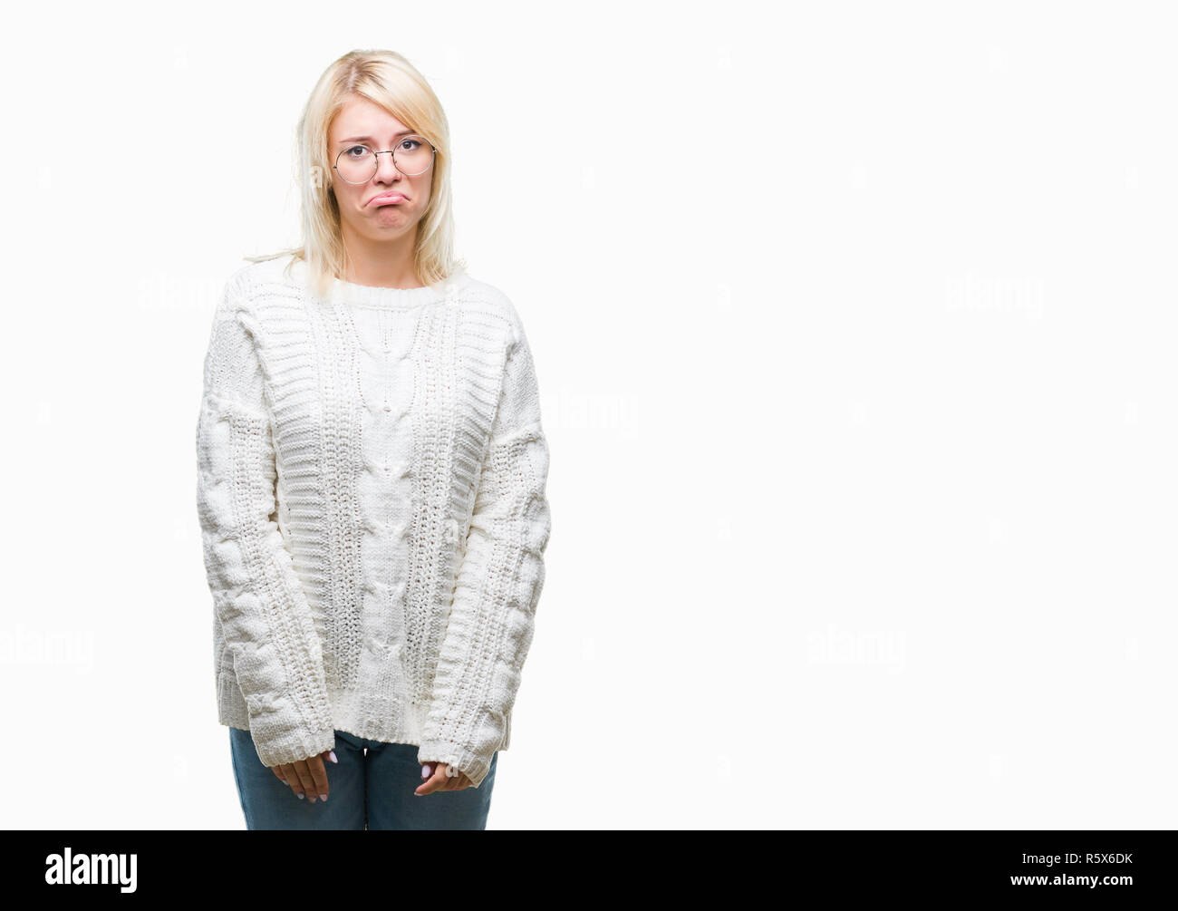 Young beautiful blonde woman wearing winter sweater and glasses over isolated background depressed and worry for distress, crying angry and afraid. Sa - Stock Image