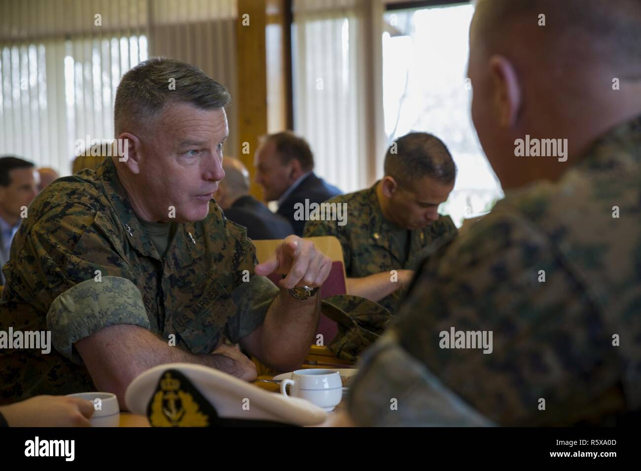 U.S. Marine Corps Maj. Gen. Niel Nelson, commanding general of Marine Corps Forces Europe and Africa, shares a meal with Marines from Marine Rotational Force Europe 17.1 (MRF-E) at Vaernes Garnison, Norway, April 18, 2017. Nelson visited with a congressional delegation to show the Marine Corps' dedication to peace and facilitate communication with partner nations. MRF-E and NATO Allies must preserve our mutual commitment and trust to confront evolving strategic challenges together. Stock Photo