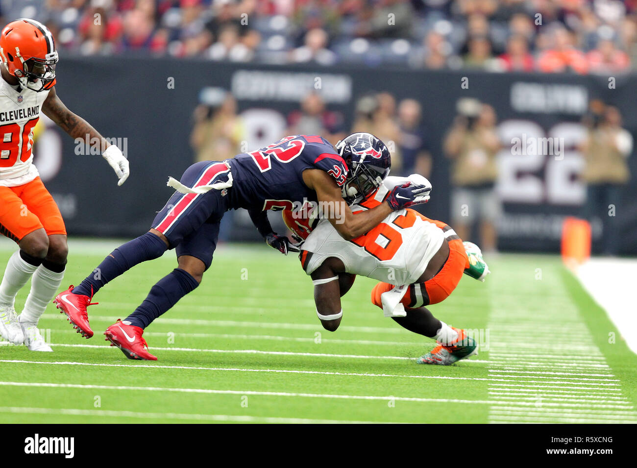 Houston, Texas, USA. 2nd Dec, 2018. Cleveland Browns tight end David Njoku (85) is tackled by Houston Texans defensive back Aaron Colvin (22) after a pass reception during the third quarter of the NFL regular season game between the Houston Texans and the Cleveland Browns at NRG Stadium in Houston, TX on December 2, 2018. Credit: Erik Williams/ZUMA Wire/Alamy Live News - Stock Image