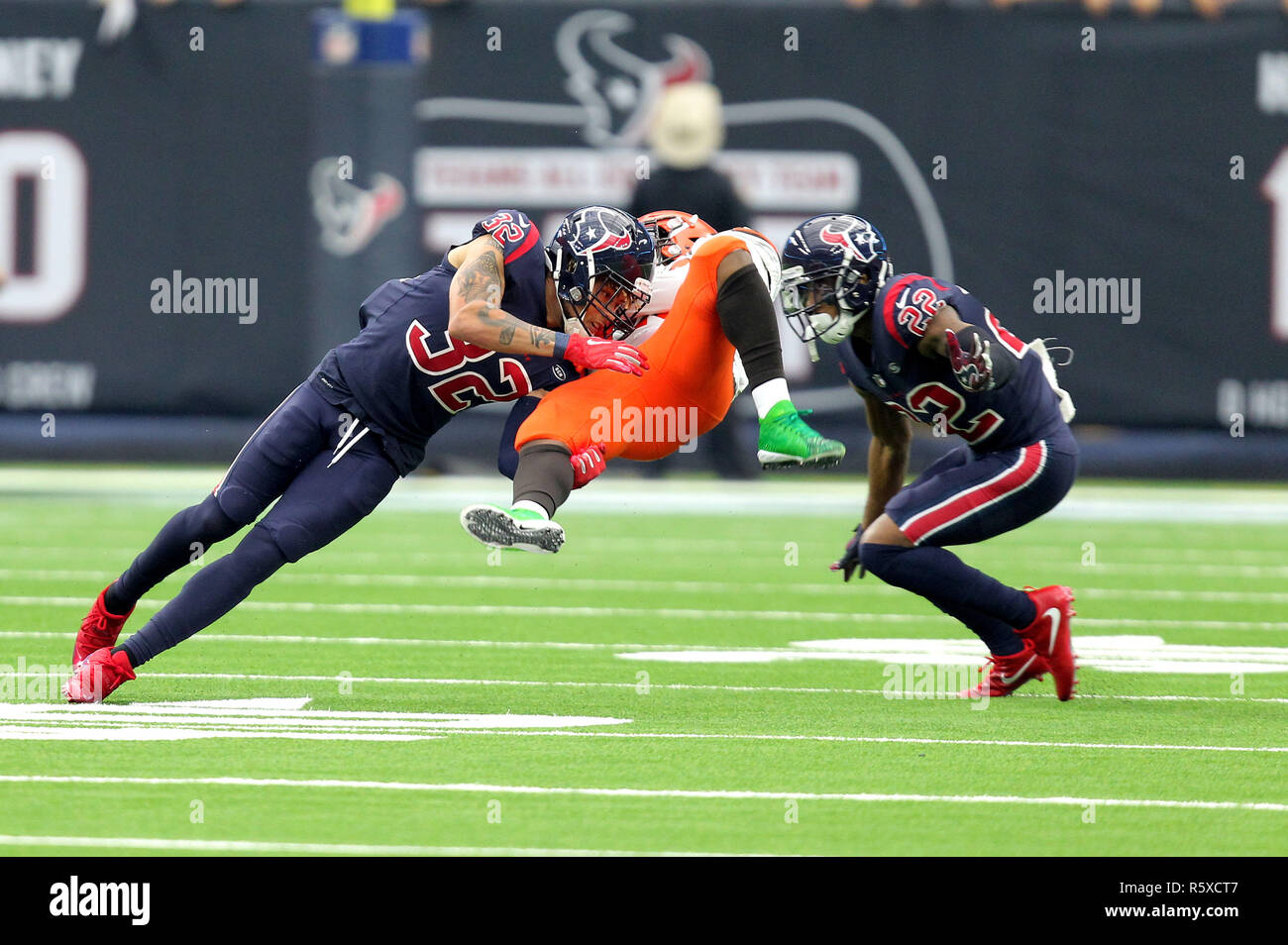 Houston, Texas, USA. 2nd Dec, 2018. Houston Texans defensive back Tyrann Mathieu (32, left) and defensive back Aaron Colvin (22) combine to tackle Cleveland Browns running back Duke Johnson (29) during the fourth quarter of the NFL regular season game between the Houston Texans and the Cleveland Browns at NRG Stadium in Houston, TX on December 2, 2018. Credit: Erik Williams/ZUMA Wire/Alamy Live News - Stock Image