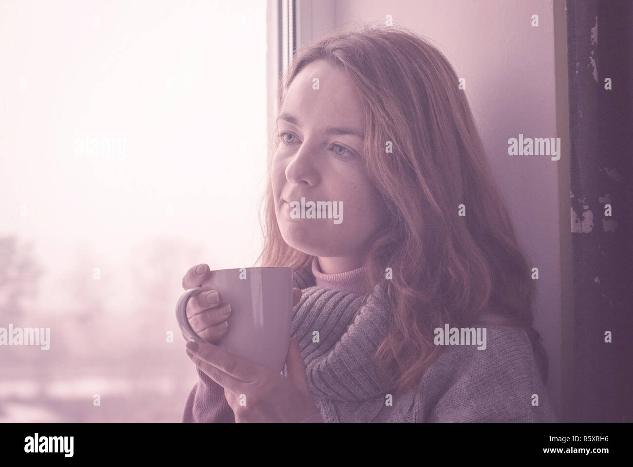 Romantic woman with cup of tea - Stock Image