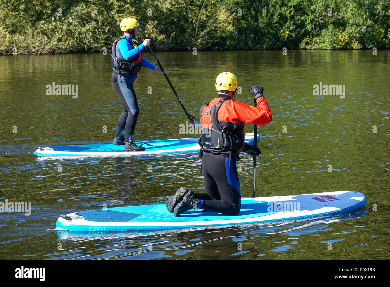 People paddleboarding on the River Thames near Medmenham, Buckinghamshire, England United Kingdom UK Stock Photo