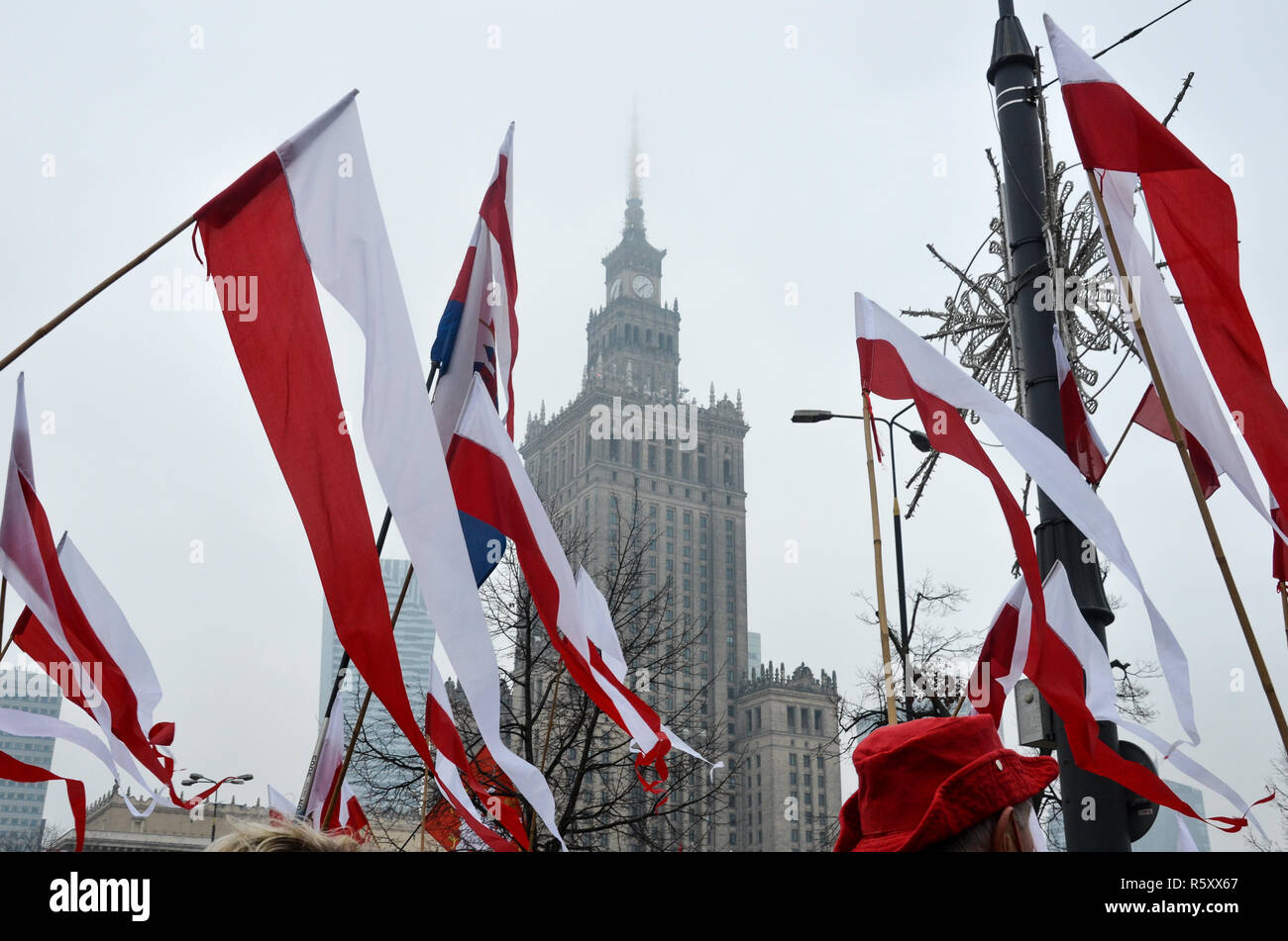 Polish flags in front of the Palace of Culture and Science, National Independence Day march, 100 year anniversary, Warsaw, 11 November, Poland, 2018 - Stock Image