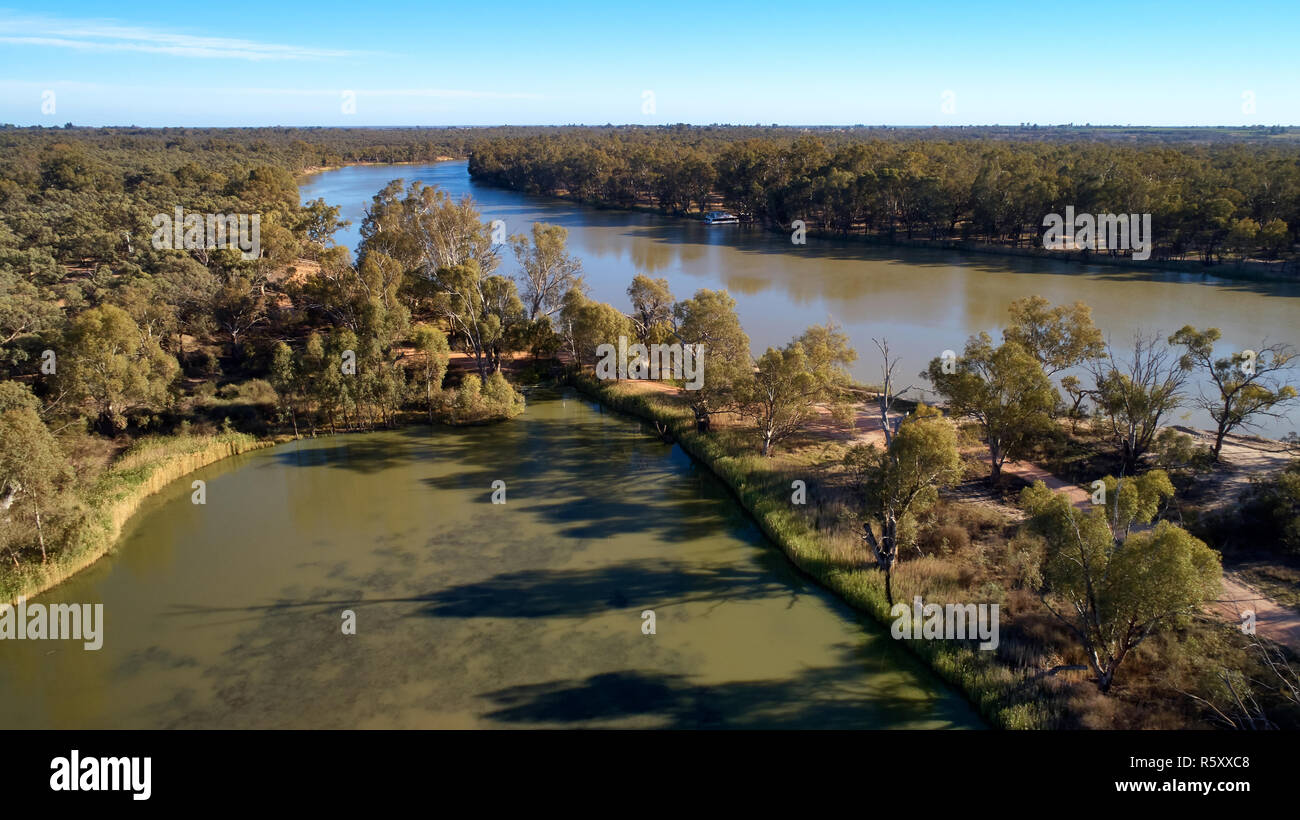 Low altitude aerial of Cowanna Billabong in the foreground with Murray River behind. - Stock Image