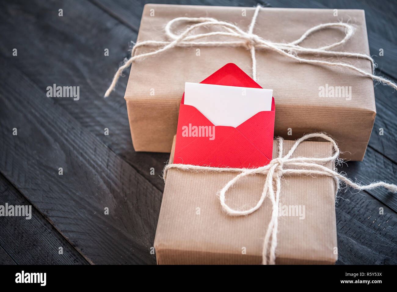 Presents and envelope with blank paper Stock Photo