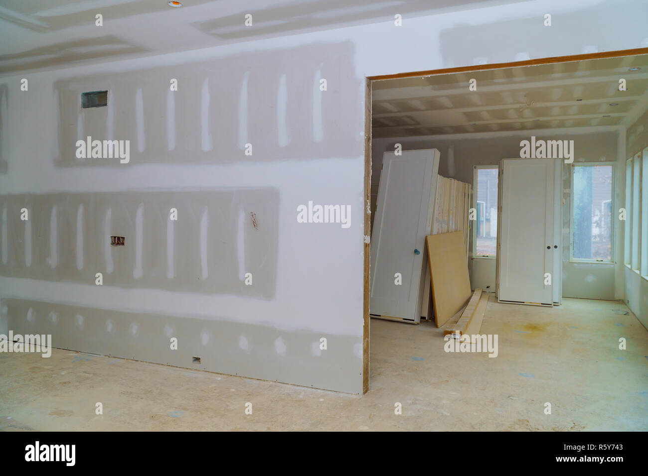 Interior construction of housing project with drywall installed door for a new home before installing & Interior construction of housing project with drywall installed door ...