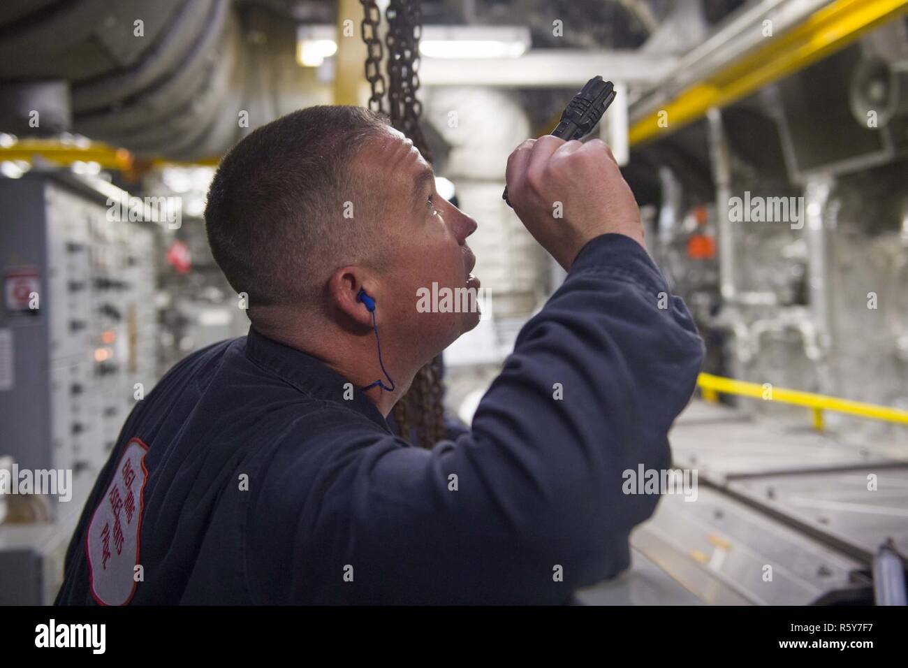 CHANGI NAVAL BASE, Singapore (April 24, 2017) Lt. Cmdr. Edward Davis, assigned to Engineering Assessments Pacific, conducts a safe-to-operate walkthrough in a main engine room during Engineering Operations Certification aboard littoral combat ship USS Coronado (LCS 4). Coronado is on a rotational deployment in U.S. 7th Fleet area of responsibility, patrolling the region's littorals and working hull-to-hull with partner navies to provide 7th Fleet with the flexible capabilities it needs now and in the future. Stock Photo