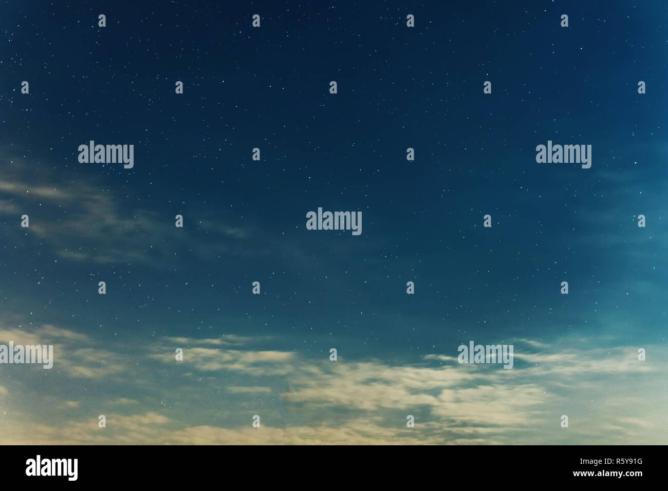 Night sky backgrounds with stars and clouds - Stock Image
