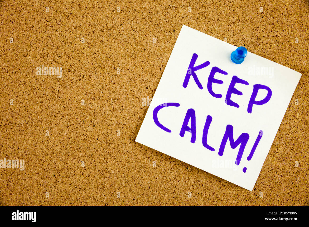a yellow sticky note writing caption inscription keep calm reminder or advice on a