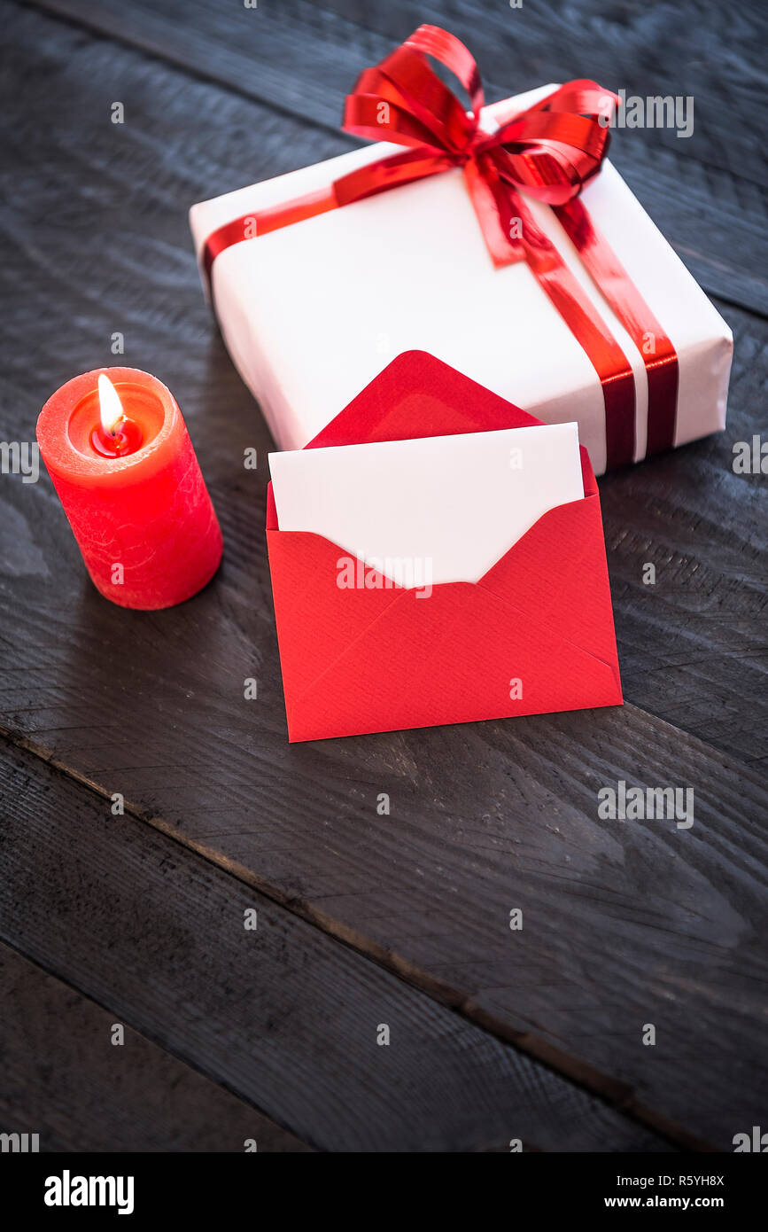 Stylish present and empty red letter Stock Photo