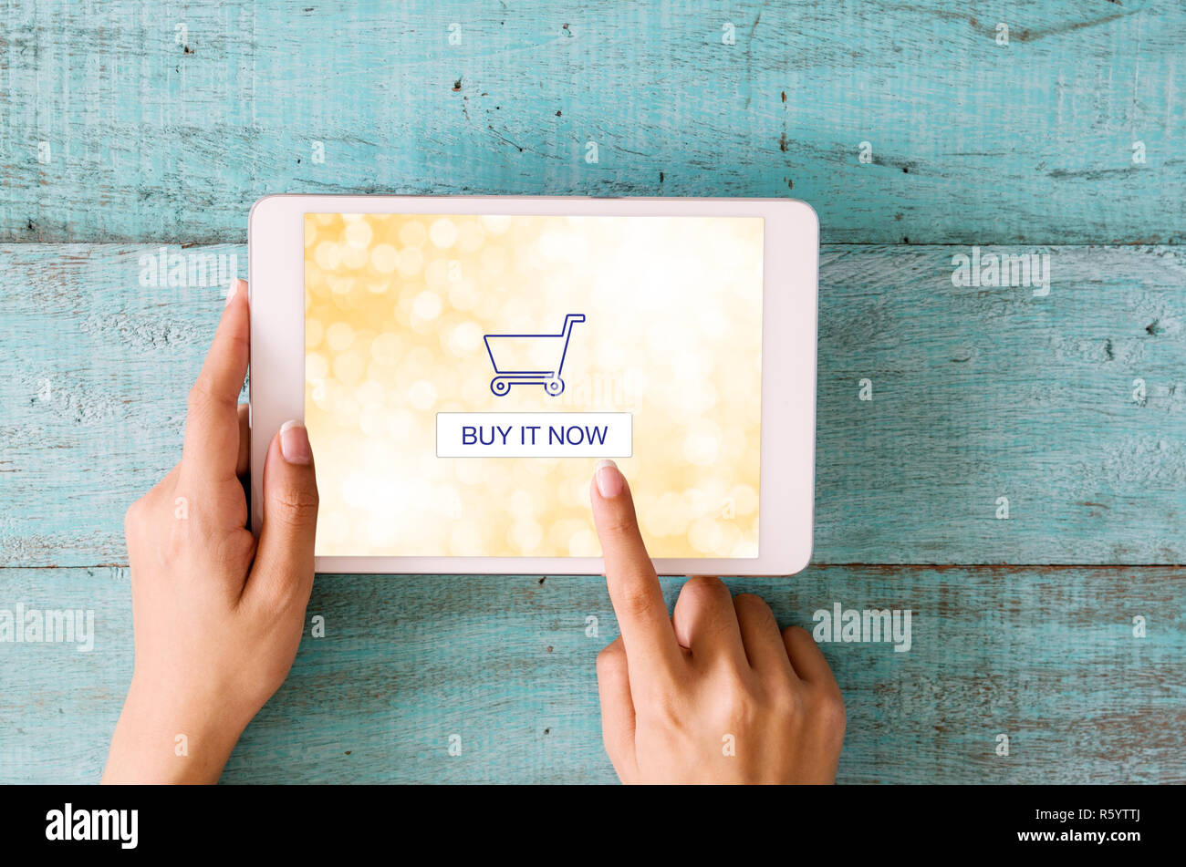 Shopping online concept. Close-up woman hands touching on digital tablet screen. - Stock Image