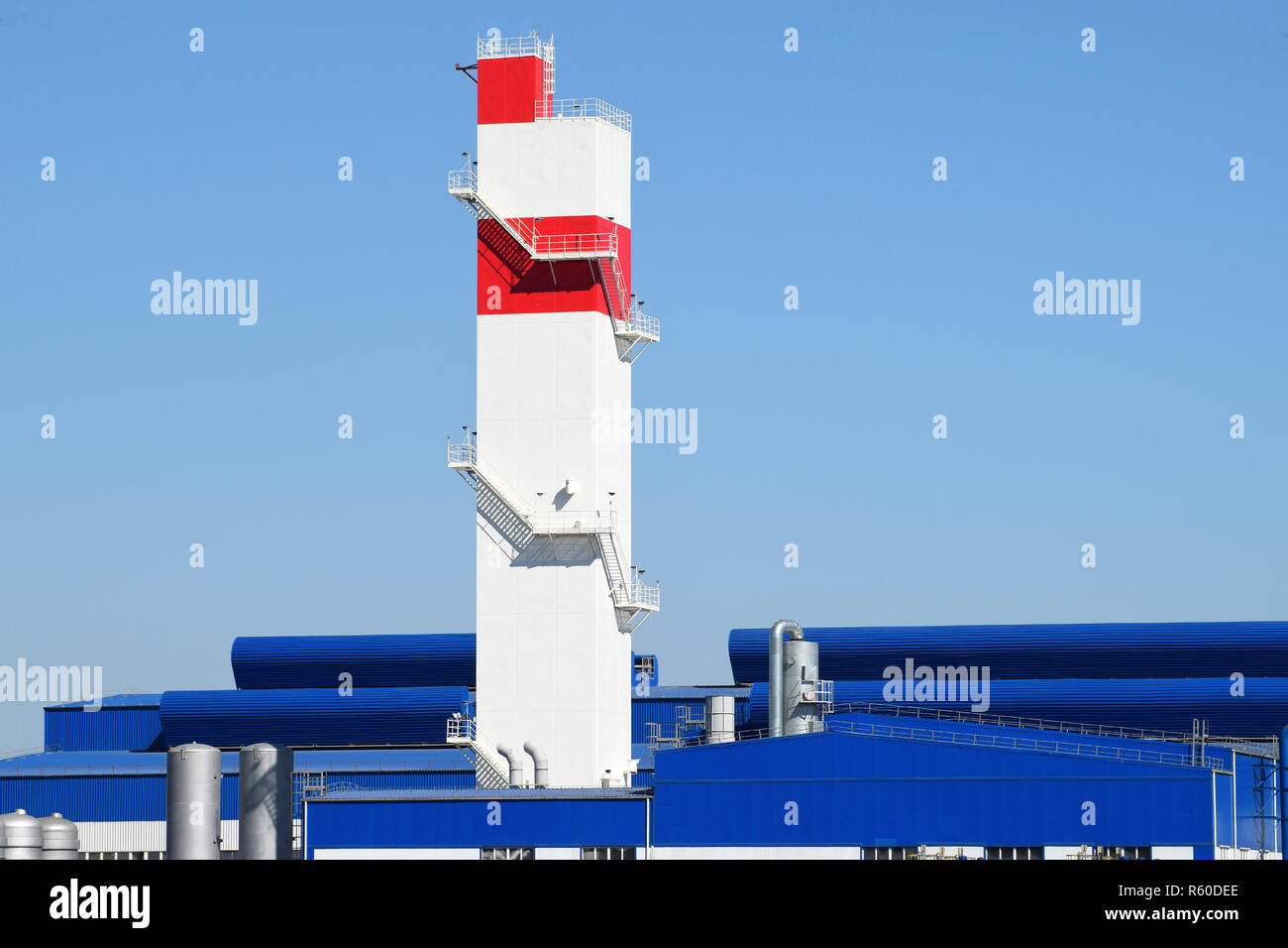 Fire tower at the plant for the processing of scrap metal. Huge - Stock Image