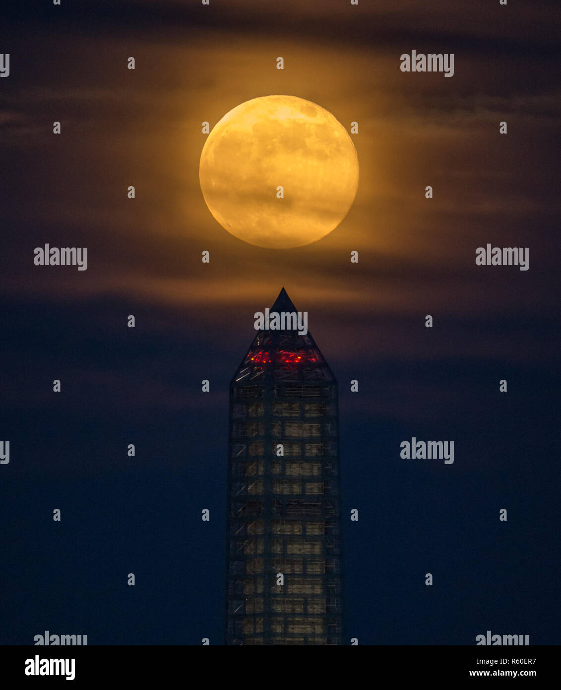 A supermoon rises behind the Washington Monument, Sunday, June 23, 2013, in Washington. This year the Supermoon is up to 13.5% larger and 30% brighter Stock Photo