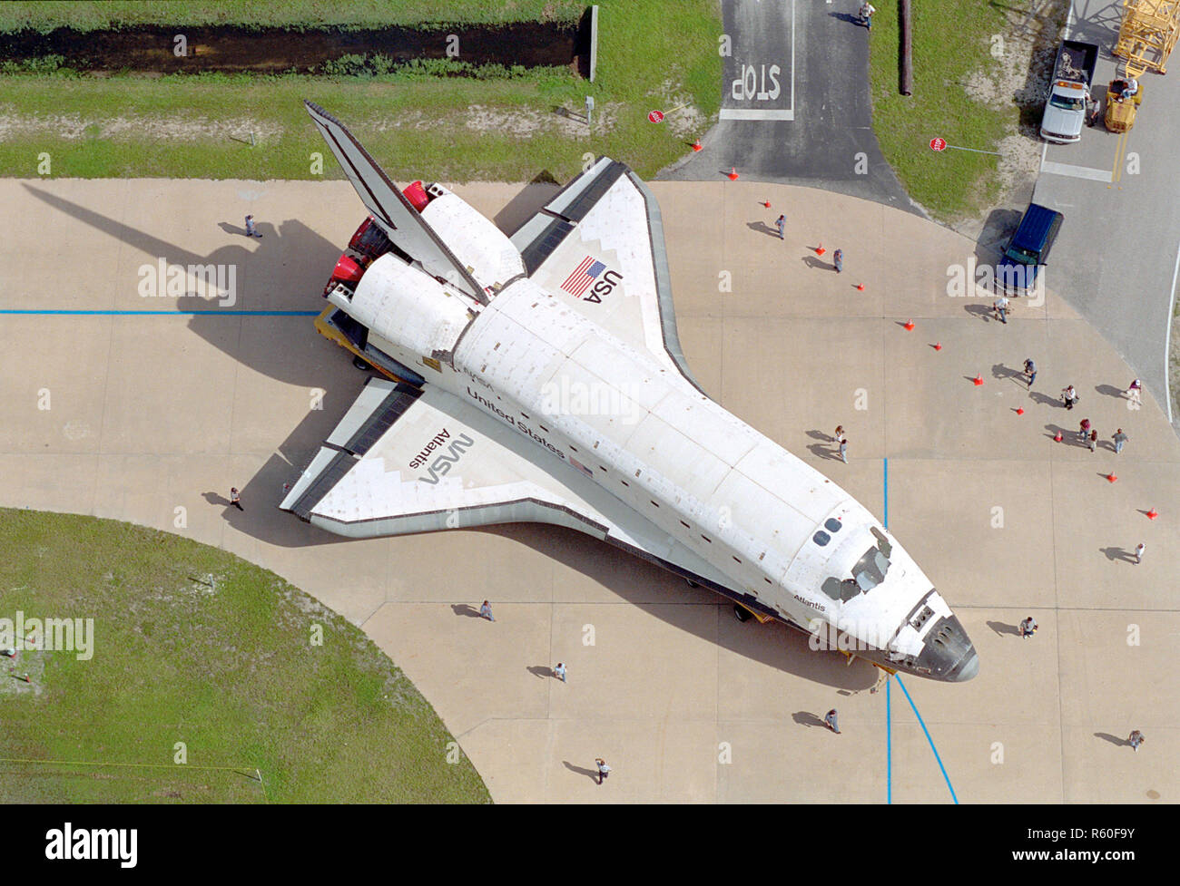 Carried atop an orbiter transporter, the Space Shuttle Orbiter Atlantis makes the short journey from Orbiter Processing Facility Bay 3 to the Vehicle  - Stock Image