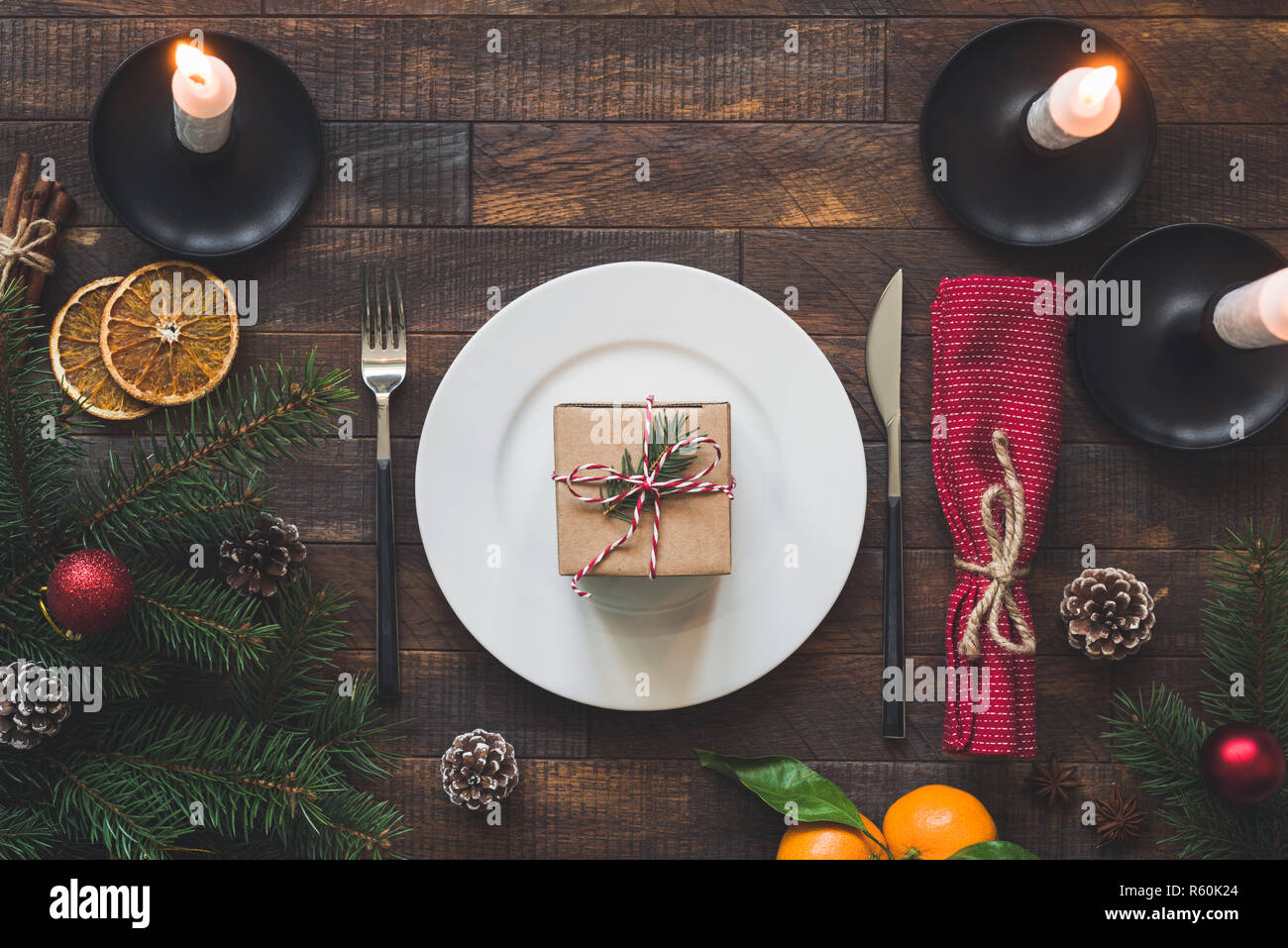 Surprising Christmas Table Setting Plate Silverware Candles And Red Download Free Architecture Designs Grimeyleaguecom