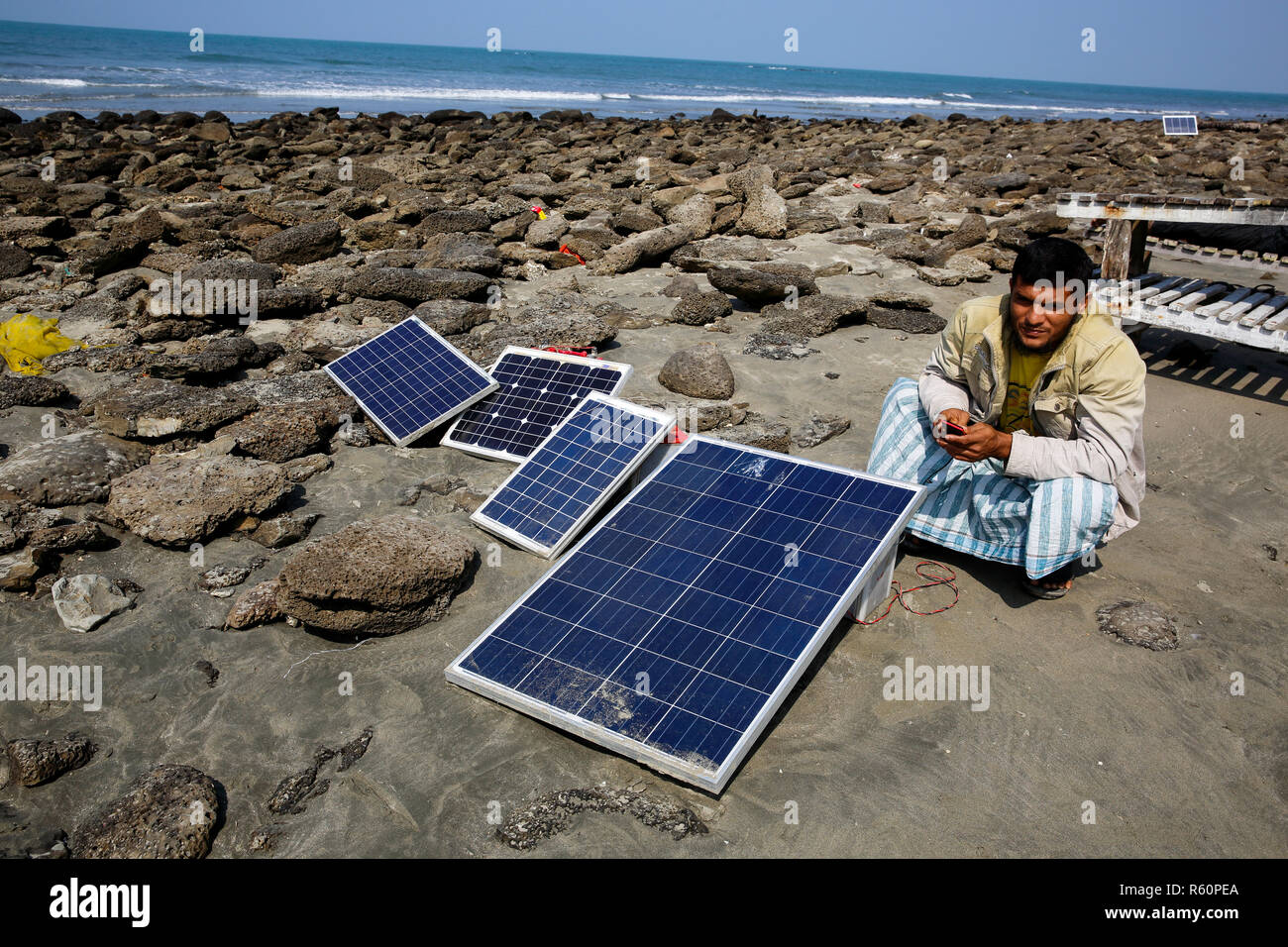 Solar panels lie under the sun on the sea beach at Saint Martin Island. Cox's Bazar, Bangladesh. Stock Photo