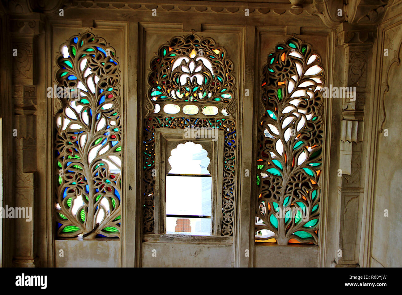 4b0e8d06ef15 Intricate and decorative etching of floral design on window panes at City  Palace