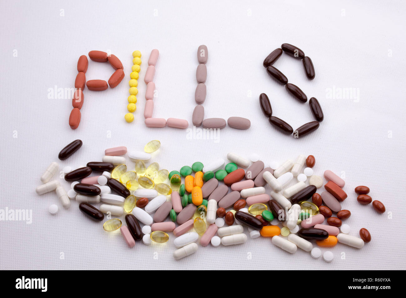 Conceptual Hand writing text caption inspiration Medical care Health concept written with pills drugs capsule word PILLS season On white isolated background with copy space - Stock Image