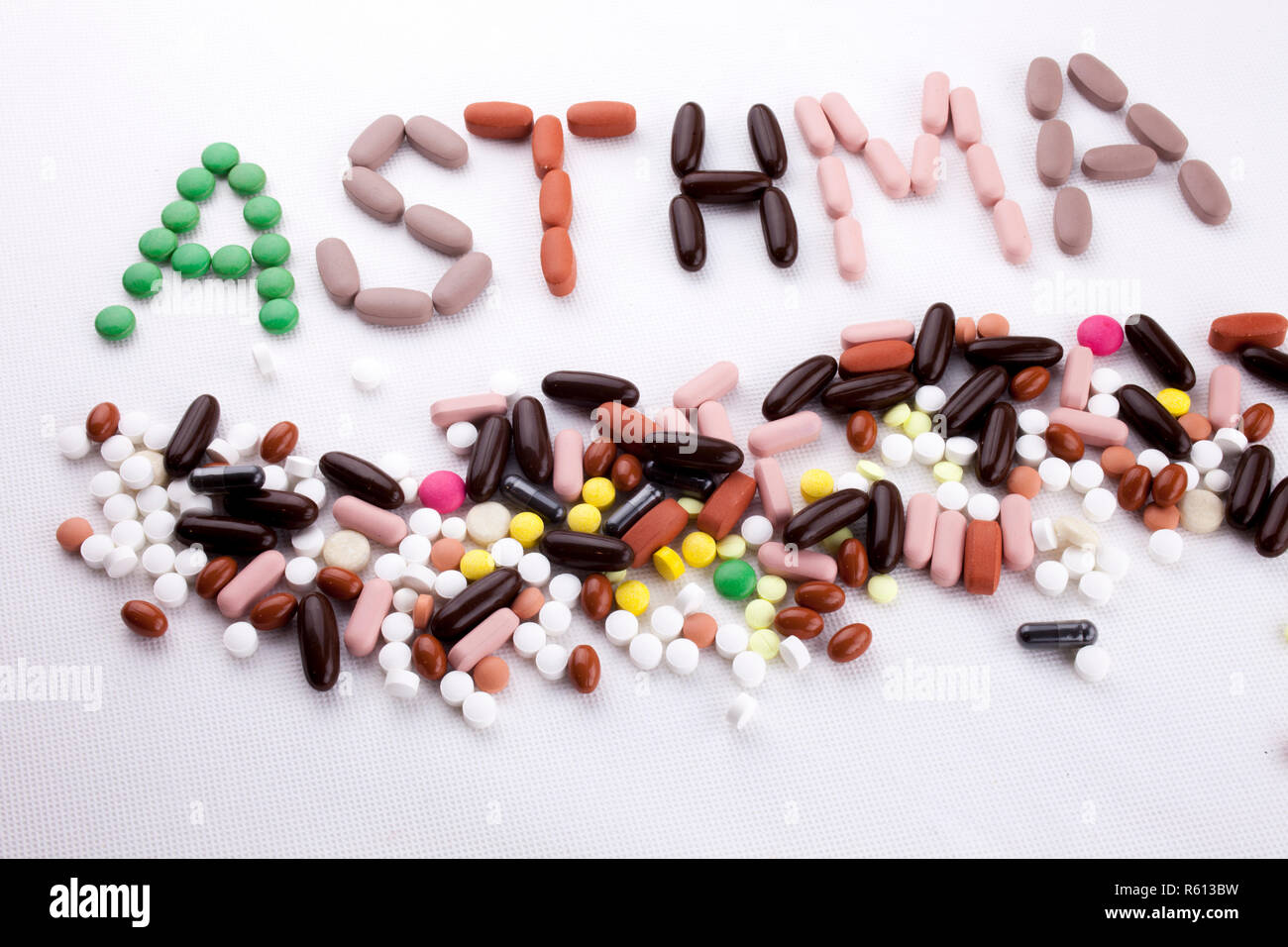 Hand writing text caption inspiration Medical care Health concept written with pills drugs capsule word asthma On white isolated background with copy space Stock Photo