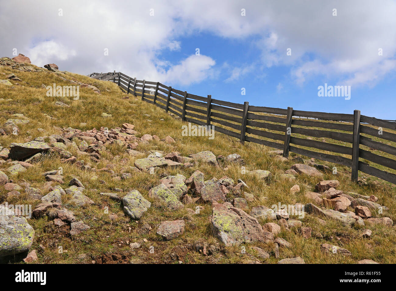 pasture fence and scree on the rittner horn Stock Photo