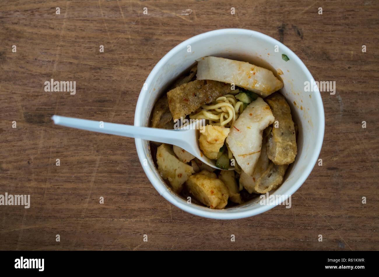 Pempek Palembang - fishcake delicacy from Palembang, Sumatra, Indonesia - with spoon - Stock Image