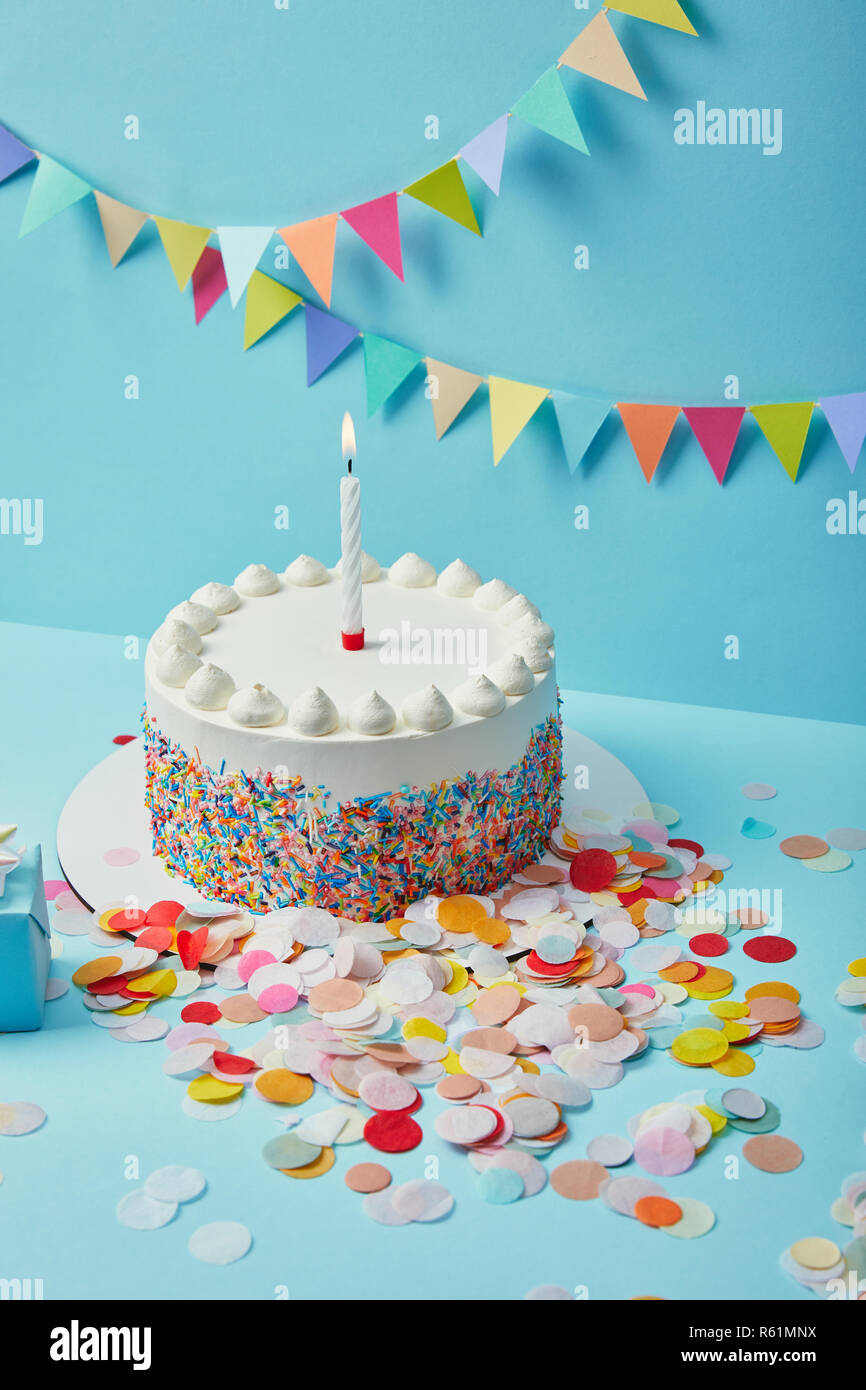 Awesome Tasty Cake With Sugar Sprinkles And Confetti On Blue Background Funny Birthday Cards Online Elaedamsfinfo