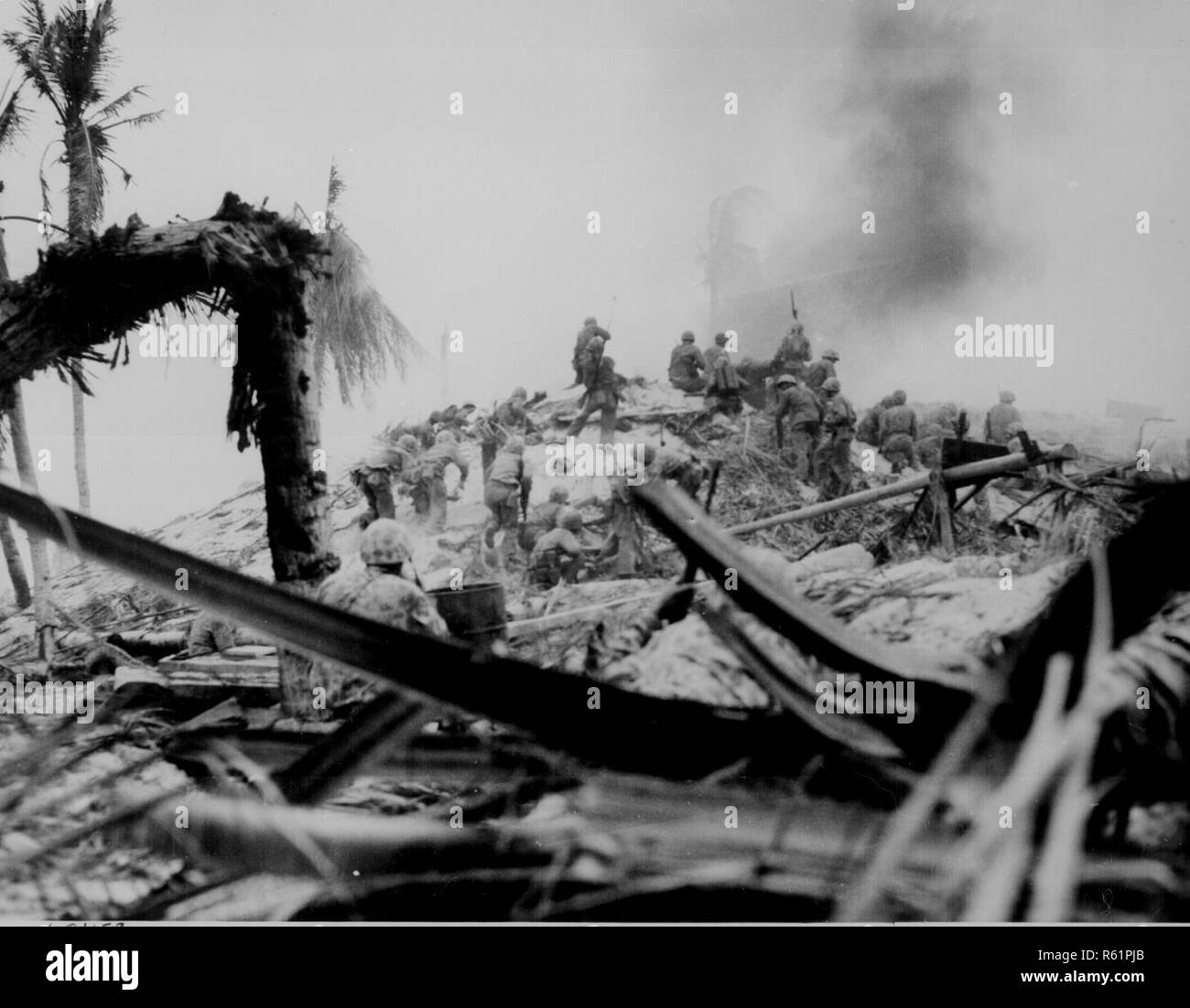 U.S. Marines storm Tarawa in the Gilbert Islands. Nov. 20, 2018 marks the 75th anniversary of the start of the Battle of Tarawa, which was part of Operation Galvanic. It marks one of the bloodiest battles of WWII. The 75th commemoration of the Battle of Tarawa is an opportunity to honor the courage, service and sacrifice of the U.S. military personnel present during the attacks. - Stock Image