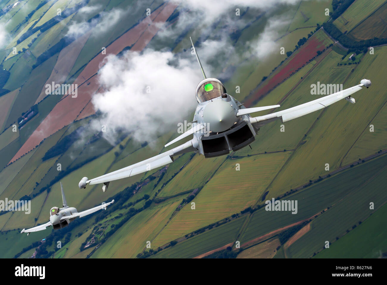 Royal Air force (RAF) Eurofighter Typhoon in flight. A twin-engine, canard-delta wing, multirole fighter. Photographed at Royal International Air Tatt Stock Photo