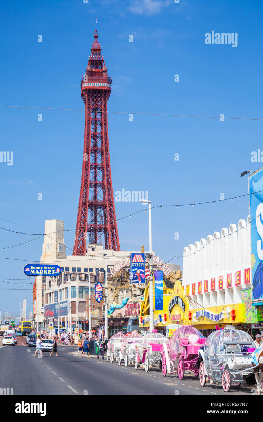 Blackpool tower and seafront promenade with amusements and horse drawn carriages Blackpool Lancashire England GB UK Europe - Stock Image