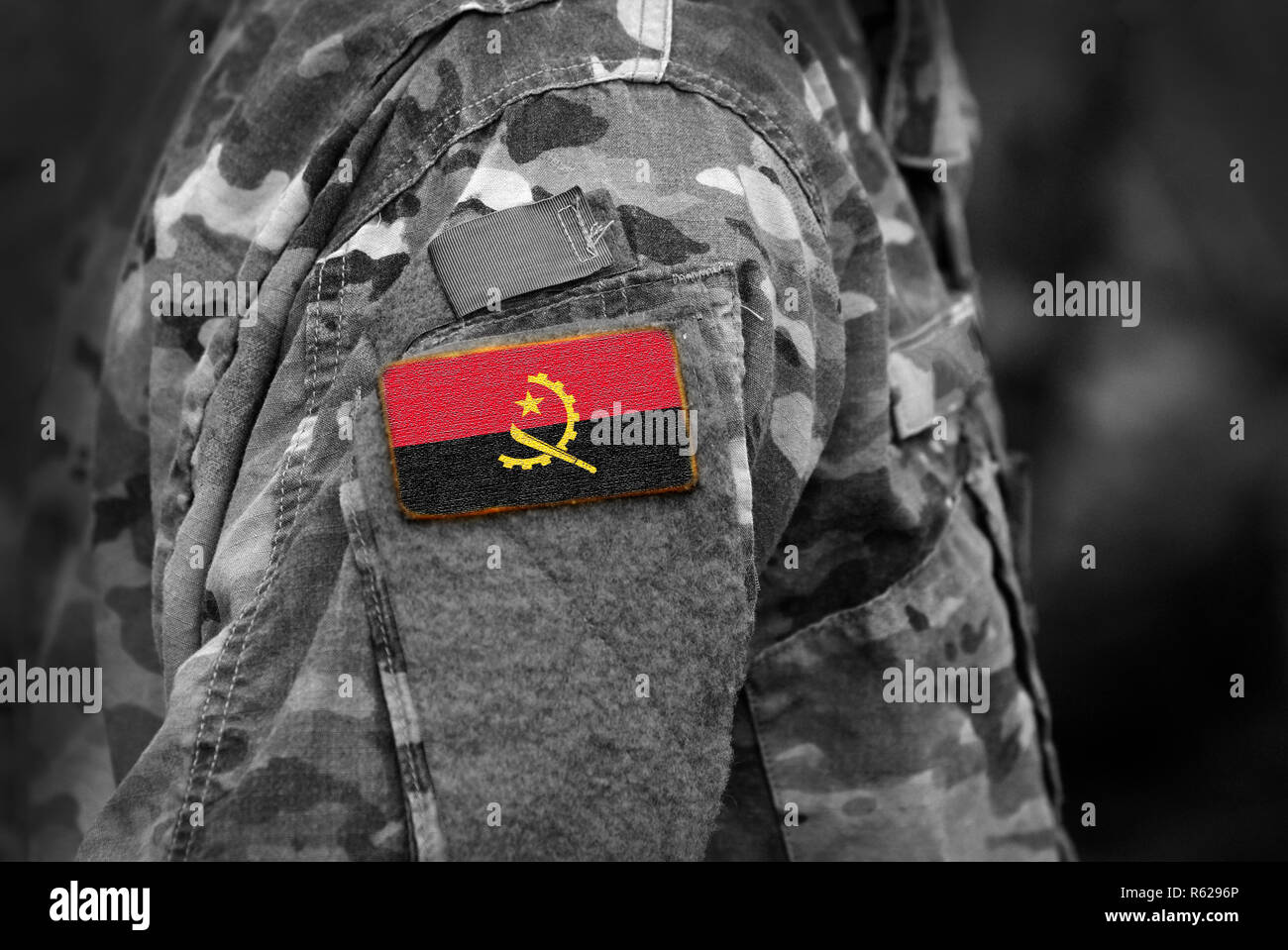 Flag of Angola on soldiers arm (collage). - Stock Image