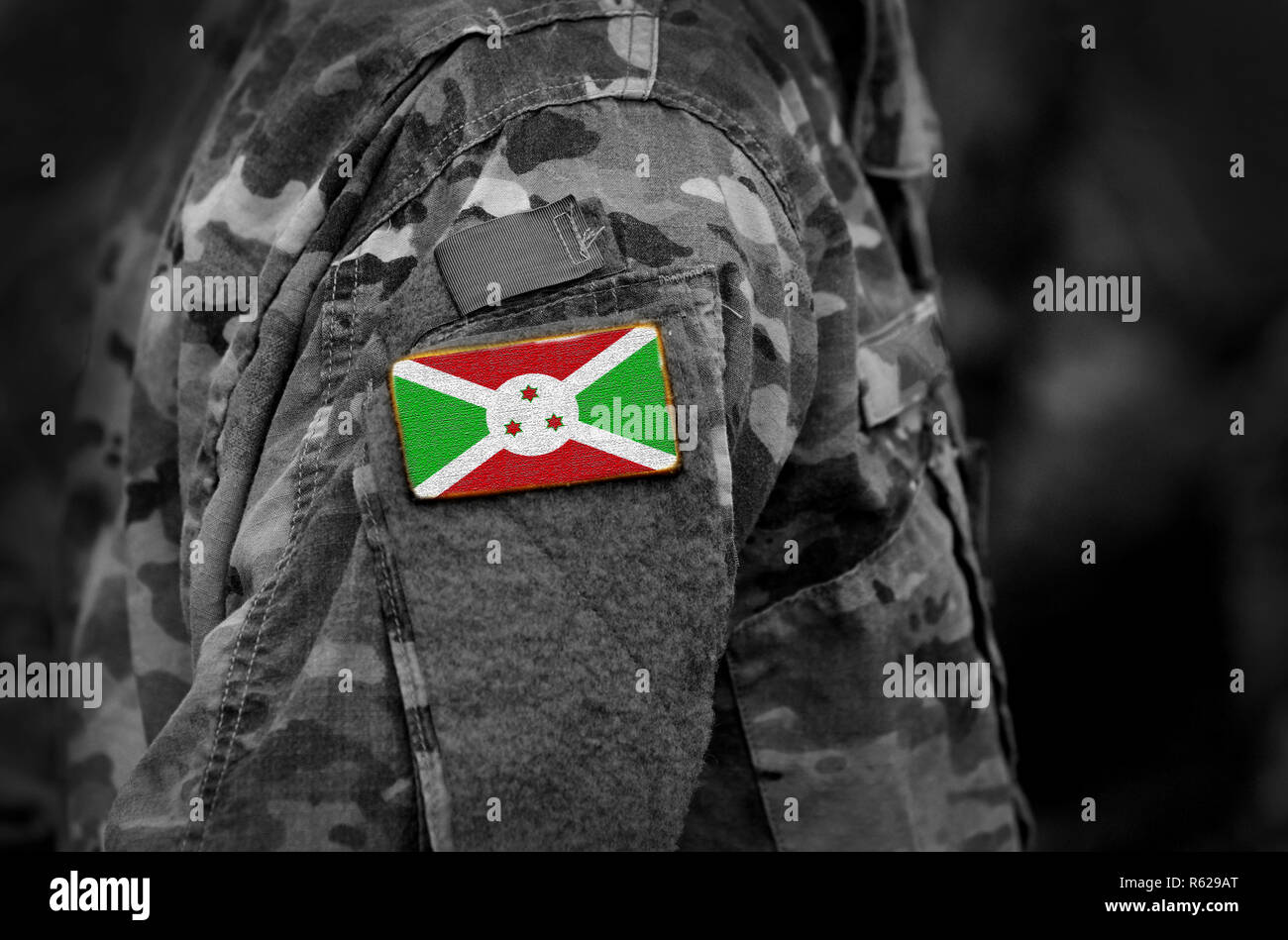 Flag of Burundi on soldiers arm (collage). - Stock Image
