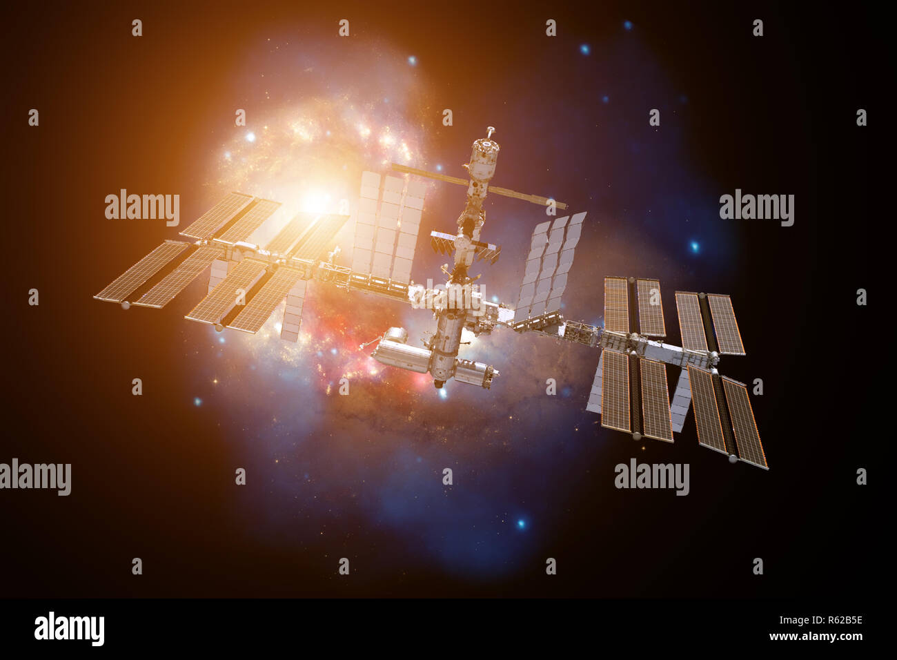 International Space Station over a galaxy. - Stock Image