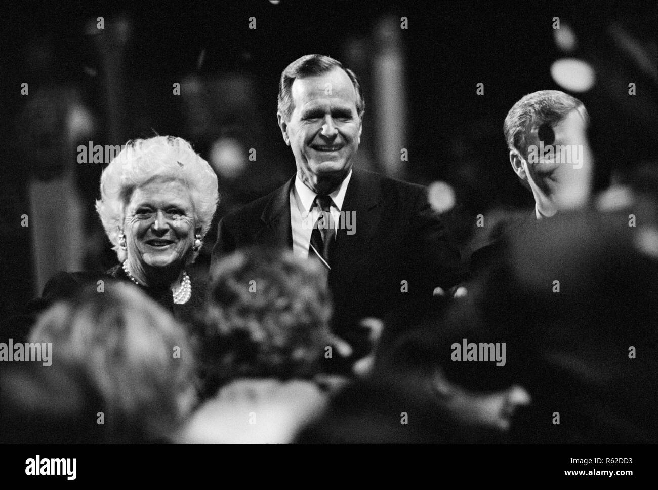 Presidential nominee George H.W. Bush, his wife Barbara Bush and vice presidential nominee Dan Quayle acknowledge the crowd at the 1992 Republican National Convention in Houston, Texas. - Stock Image