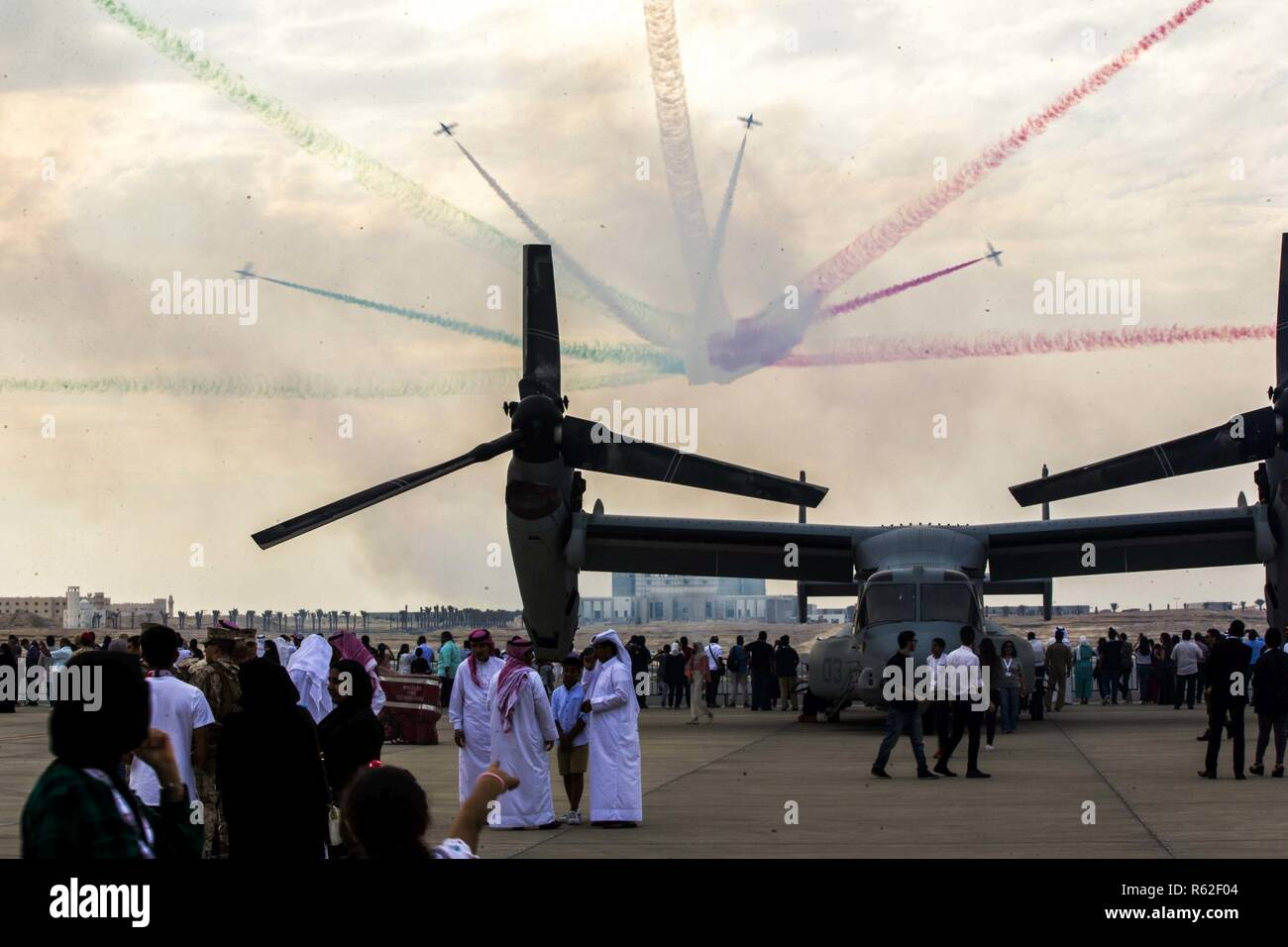 SAKHIR AIRBASE, Bahrain (Nov. 16, 2018) - Members of the Italian Frecce Tricolori Aereo fly their Aermacchi MB-339 over an MV-22B Osprey during the Bahrain International Airshow (BIAS) 18. BIAS, a biennial event, is an opportunity to strengthen military-to-military relationships with regional partners and European allies. - Stock Image