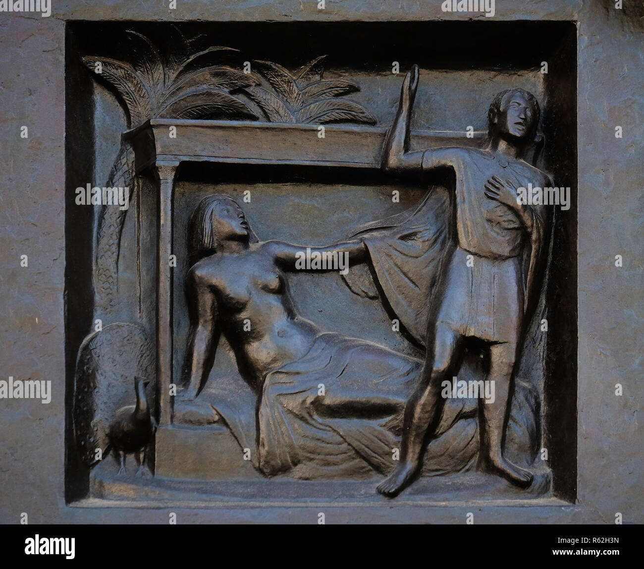 Thou shalt not commit adultery - Joseph and Potiphar's wife, relief on the door of the Grossmunster ('great minster') church in Zurich, Switzerland - Stock Image
