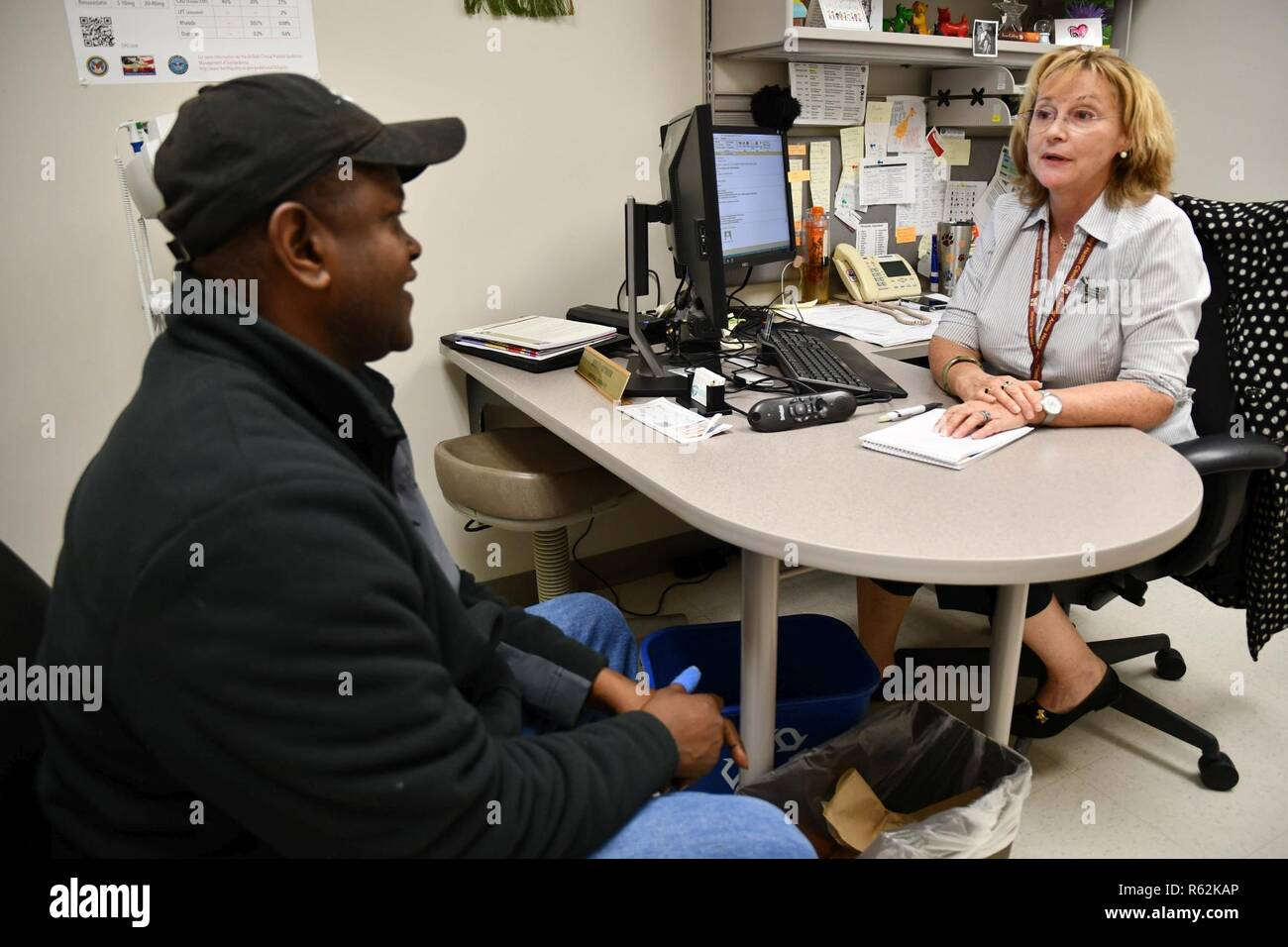 Clinical Pharmacist Kelly Authier discusses nutrition, exercise and other health maintenance issues with military retiree Everett Stevens during a Nov. 19 appointment in her office at Kenner Army Health Clinic. - Stock Image