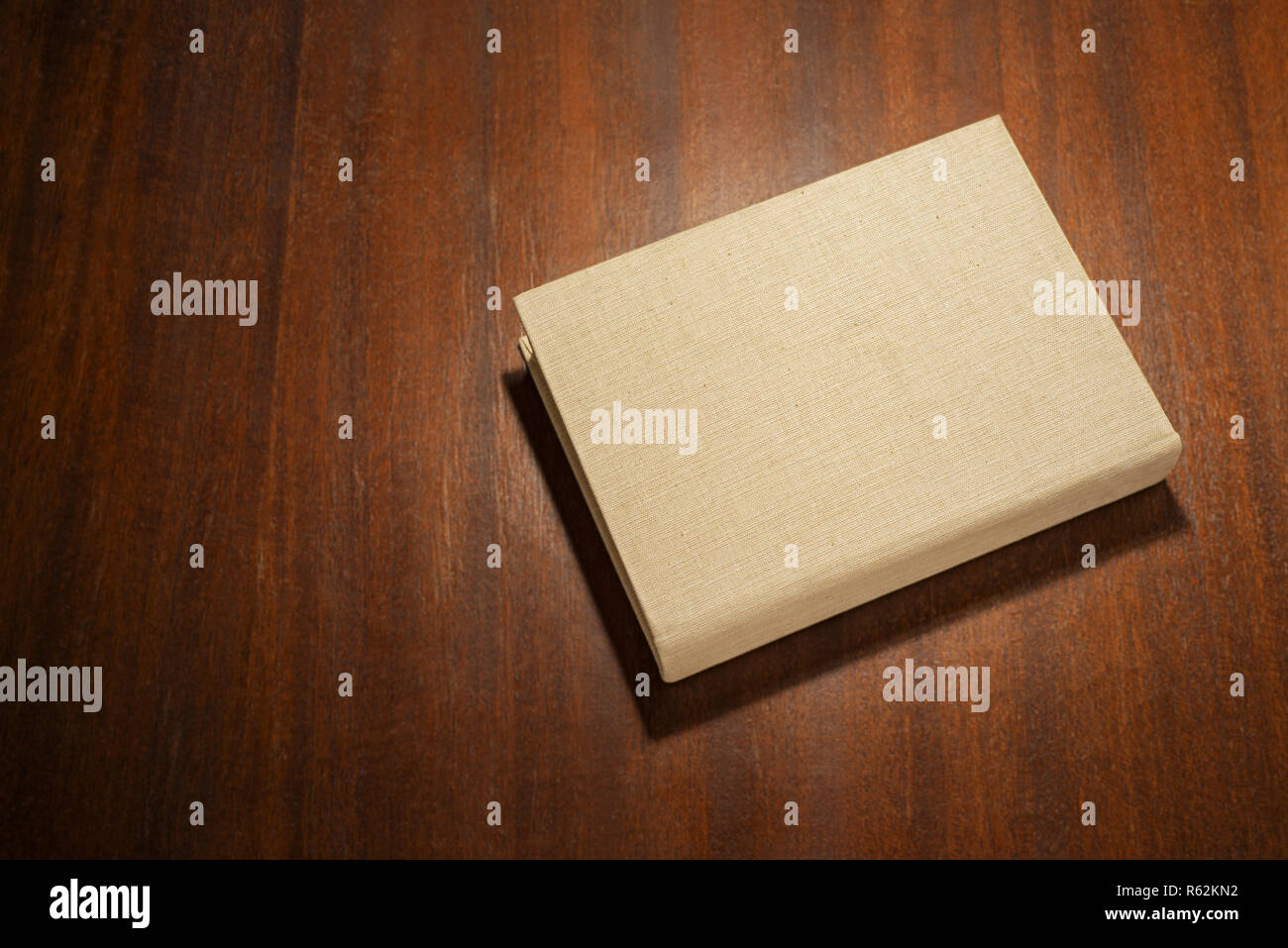 Beige color book on the wooden scratched table Stock Photo