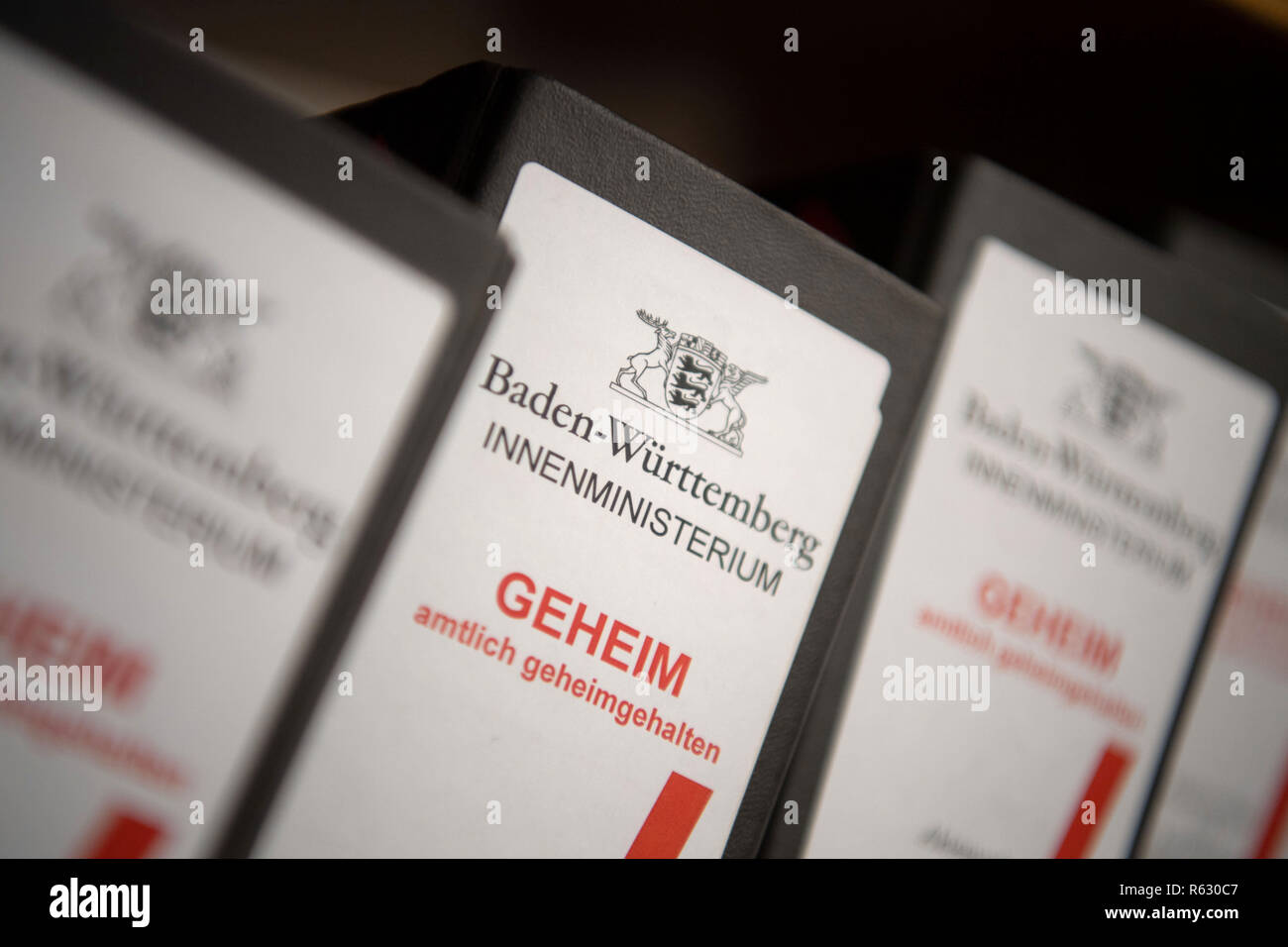 """Stuttgart, Germany. 03rd Dec, 2018. Files marked """"Baden-Württemberg Innenministerium - Geheim - amtlich geheimgehalten"""" (Baden-Württemberg Ministry of the Interior - Secret - Officially Secret) are placed on a shelf during a photo session with files on the Baden-Württemberg NSU Investigation Committee. (to dpa """"NSU committee demands fight against right-wing rock in schools"""" of 03.12.2018) Credit: Marijan Murat/dpa/Alamy Live News Stock Photo"""